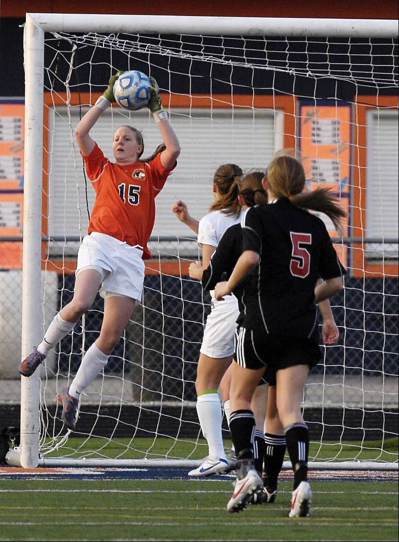 Naperville North's goalie Allison Hitchcock blocks a shot during Wednesday's game against Barrington.