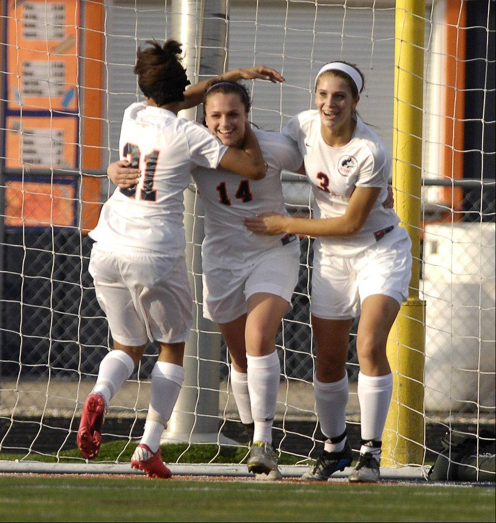 Naperville North's Christa Szalach is congratulated by teammates Zoe Swift and Kayla Sharples after scoring the only goal of the match against Barrington Wednesday.