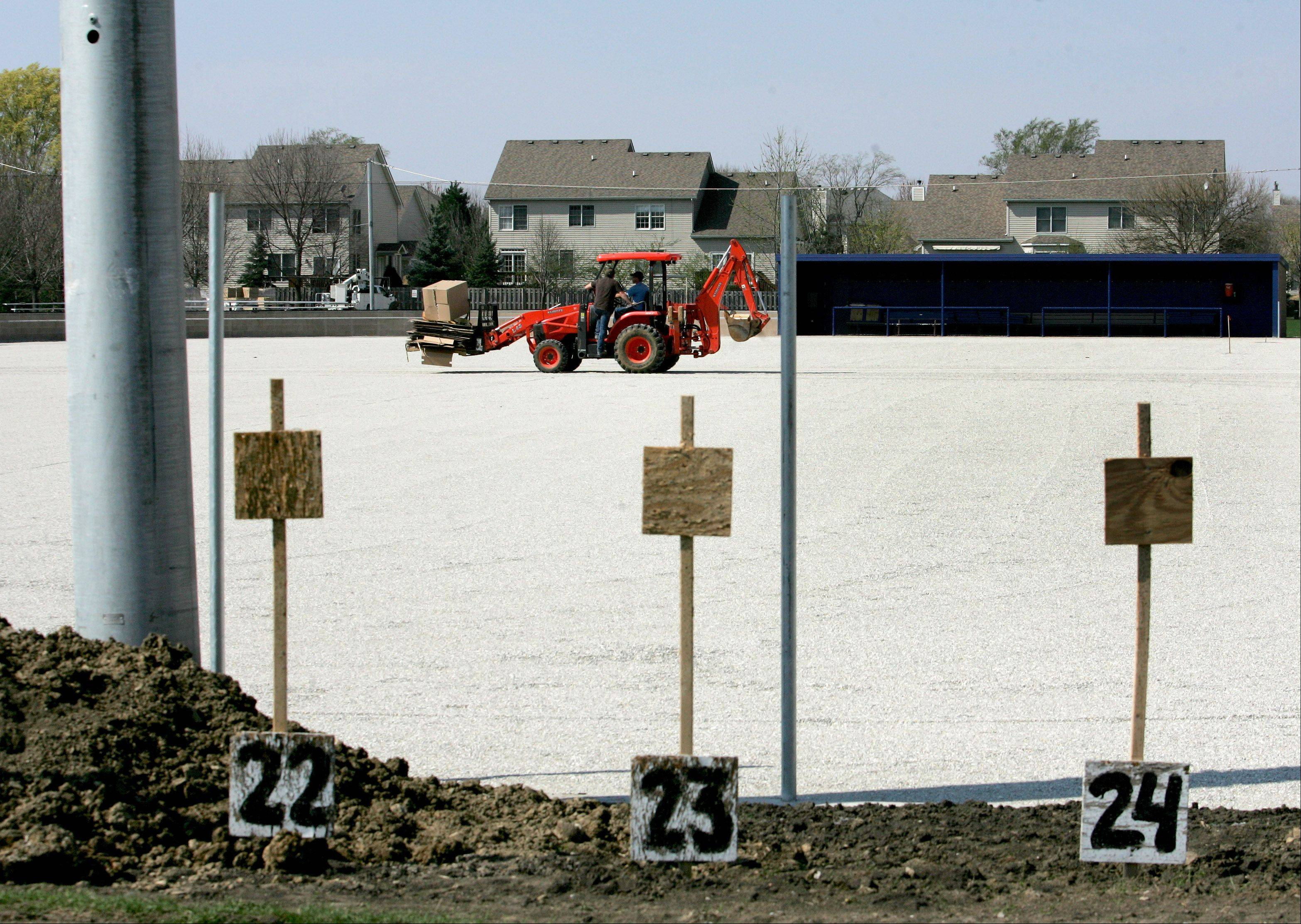 Artificial field turf and lights are being added to the baseball field behind the American Legion post in Carol Stream as part of a $3 million upgrade by Wheaton College, whose baseball team will play home games there.