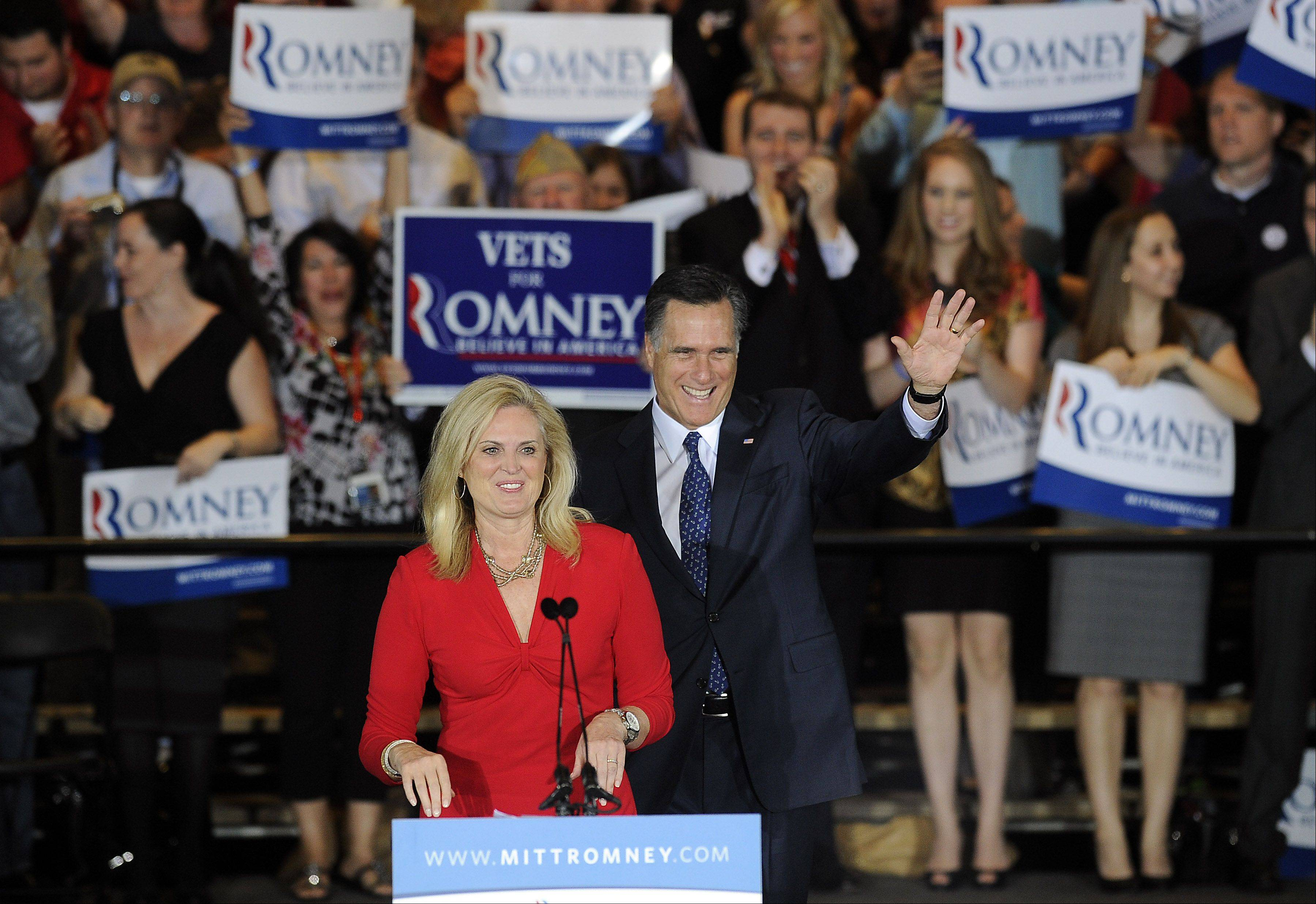 Mark Welsh/mwelsh@dailyherald.comMitt and Ann Romney in Schaumburg after he wins the Illinois Primary.