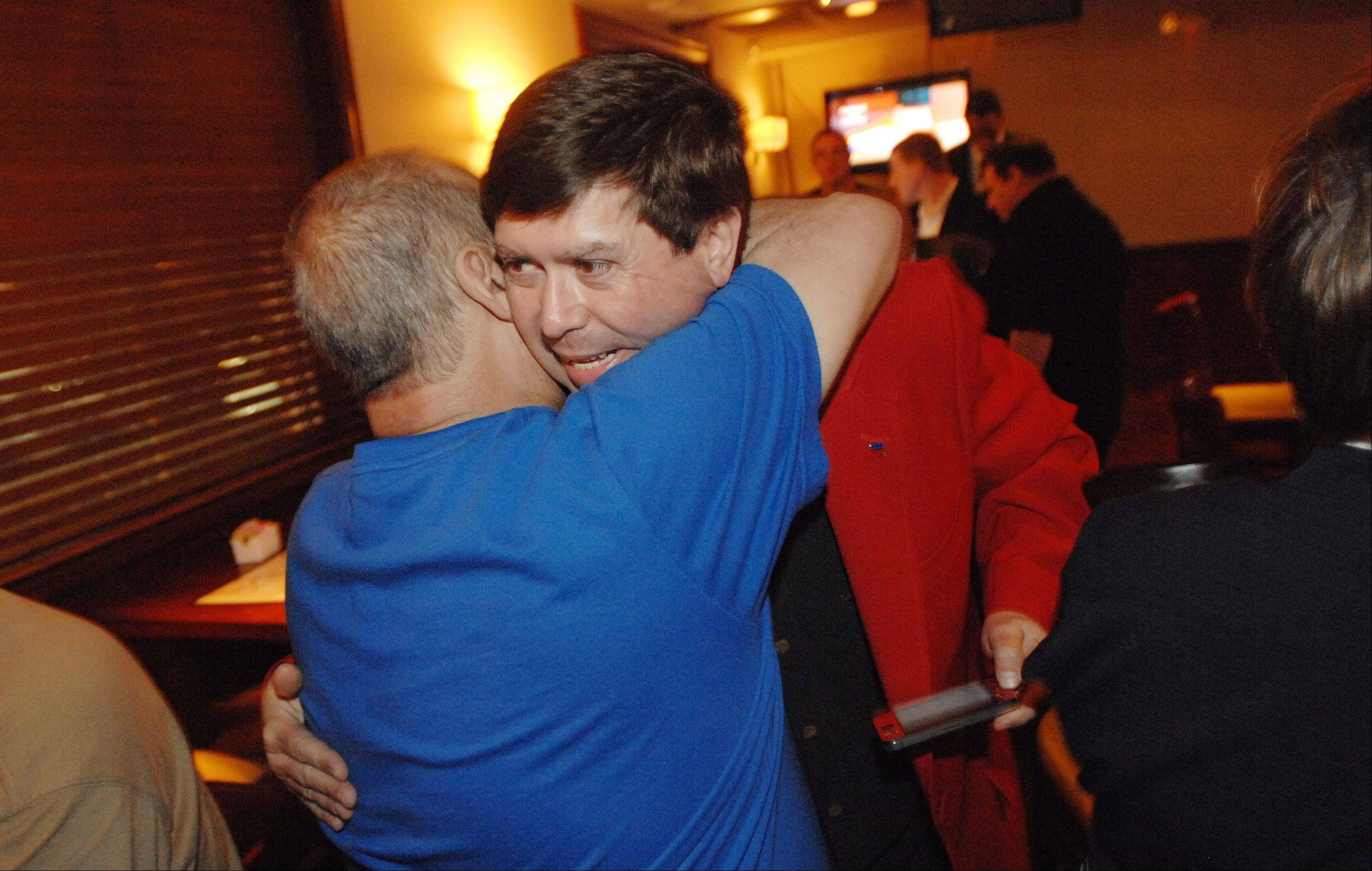 John Piemonte of Carol Stream ,left, hugs Randy Ramey, candidate for the Republican 23rd District Senate seat. Ramey attended an election night party at John and Tony's in West Chicago.