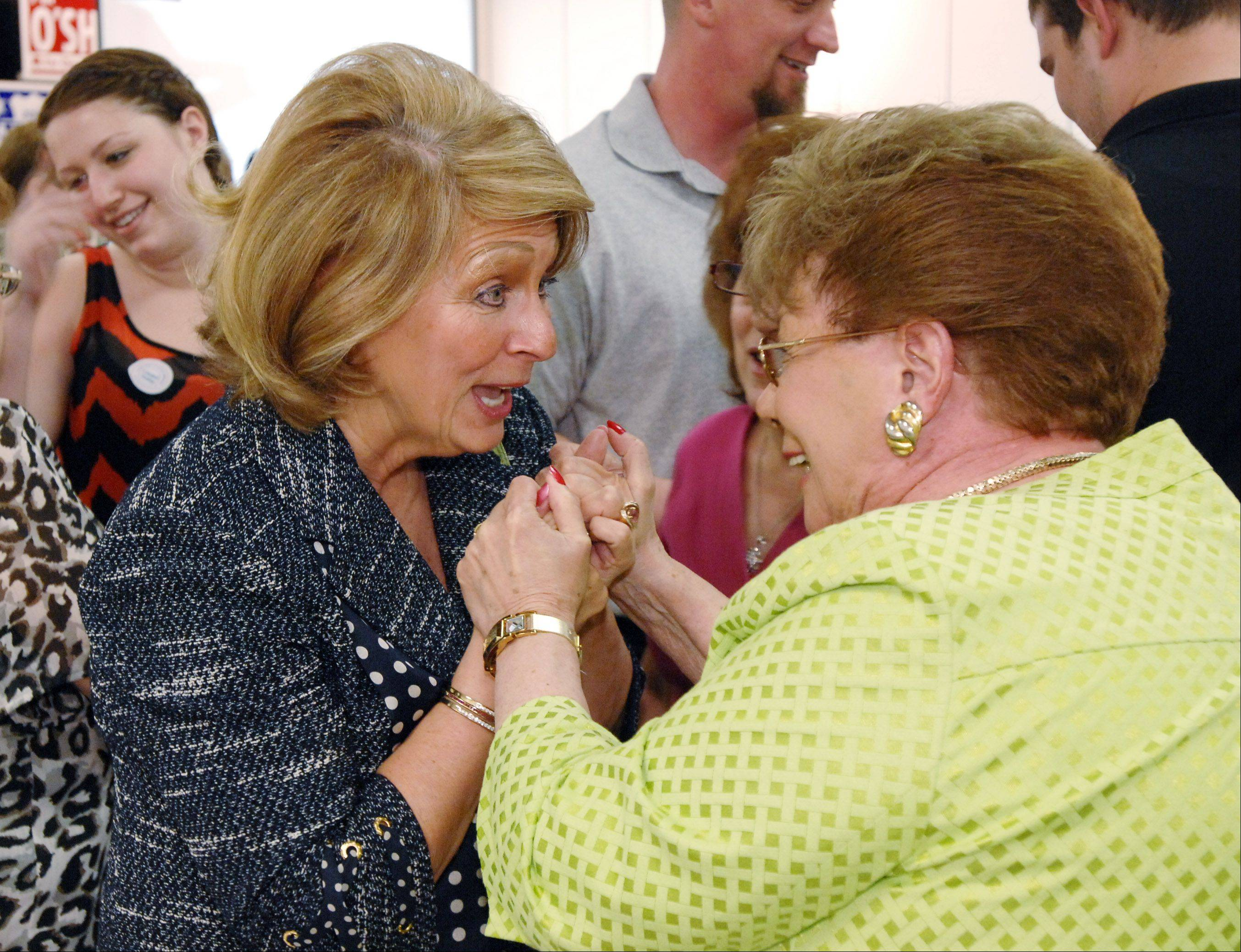 District 23 State Senator Carole Pankau greets supporter and Bloomingdale Township Clerk Fran Scalafini at the Bloomingdale Township Republican headquarters as they await election returns. Pankau won the nomination and advances to the November general election.