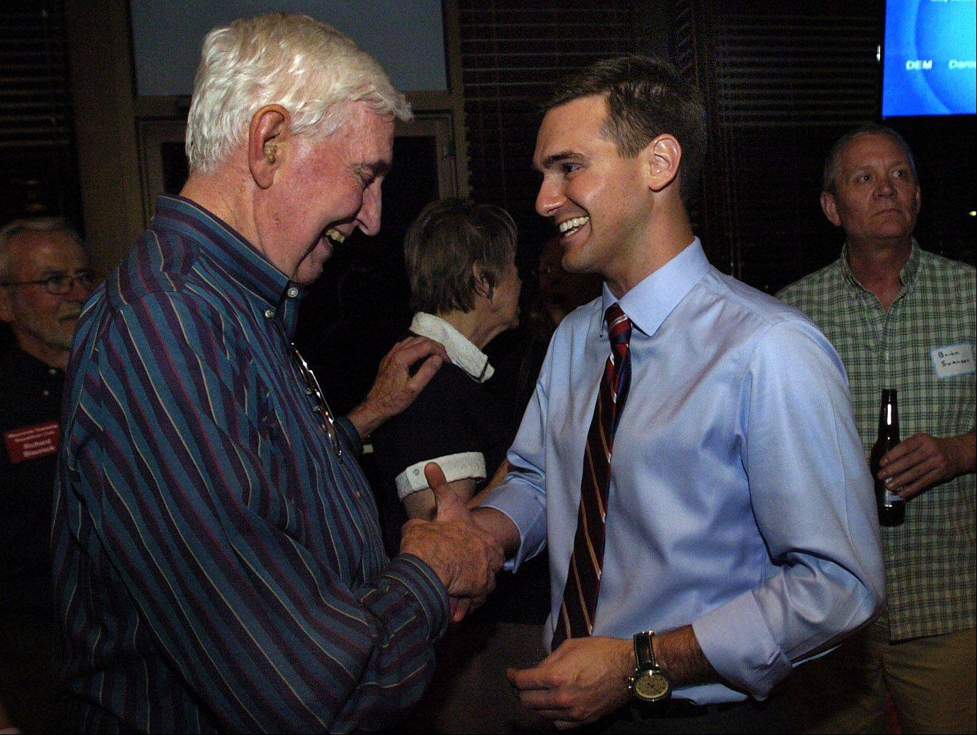 Lake Board District 17 candidate Nick Sauer, right, is congratulated by retiring Lake County Board member Steve Mountsier after claiming victory.