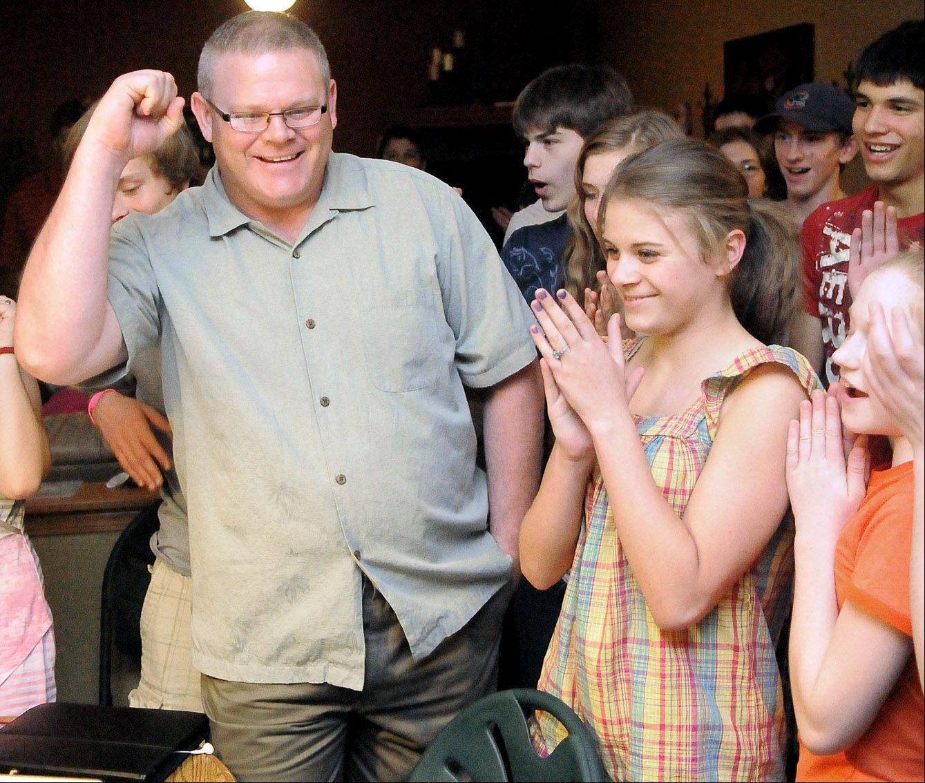 Republican Rob Russell celebrates his large-margin lead in the Kane County Coroner race, announcing it to his family, friends and children, including daughter Brie, 16, at right.