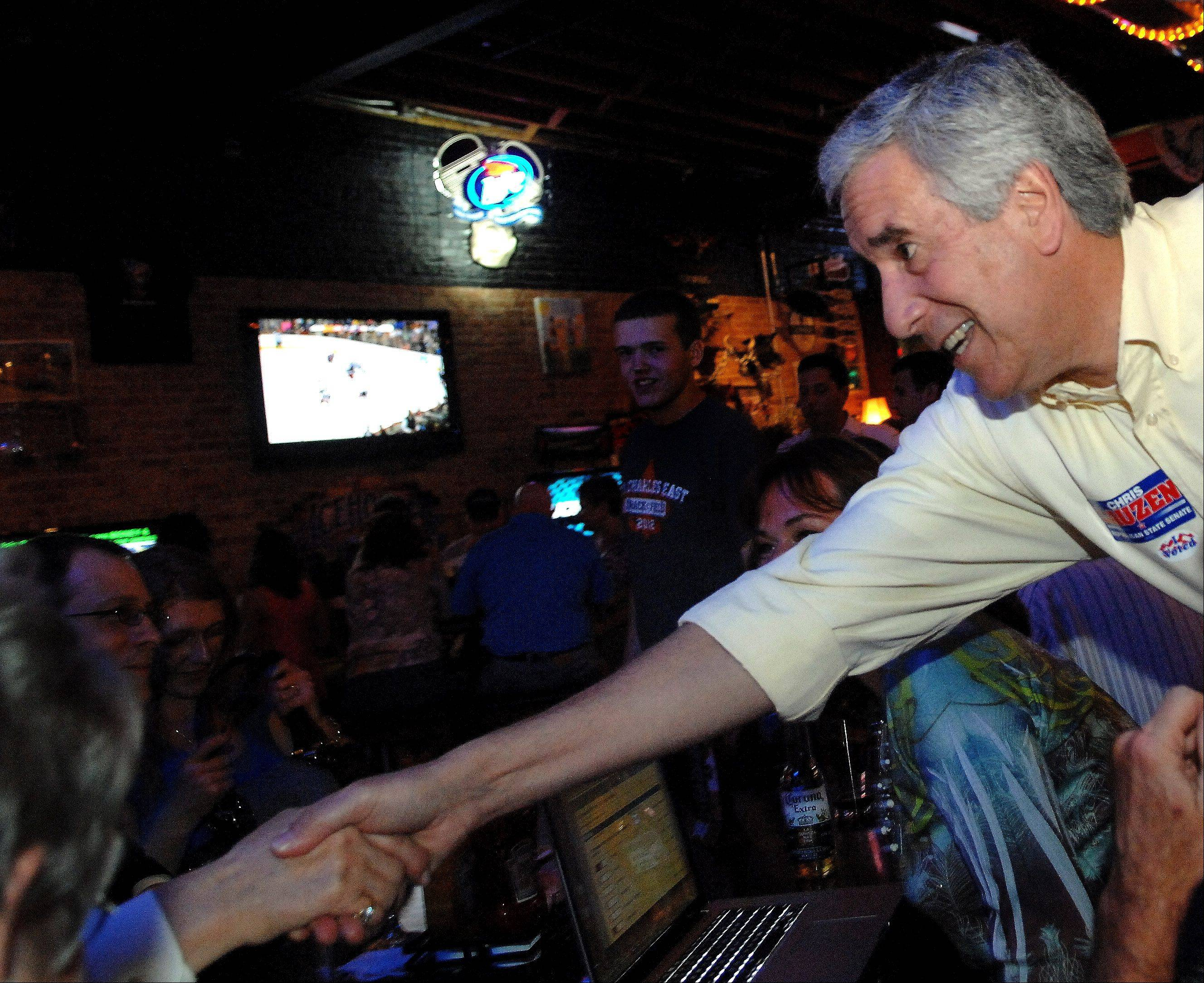 Republican candidate for Kane County Board Chairman Chris Lauzen shakes hands with supporters at Alley 64 in St. Charles.