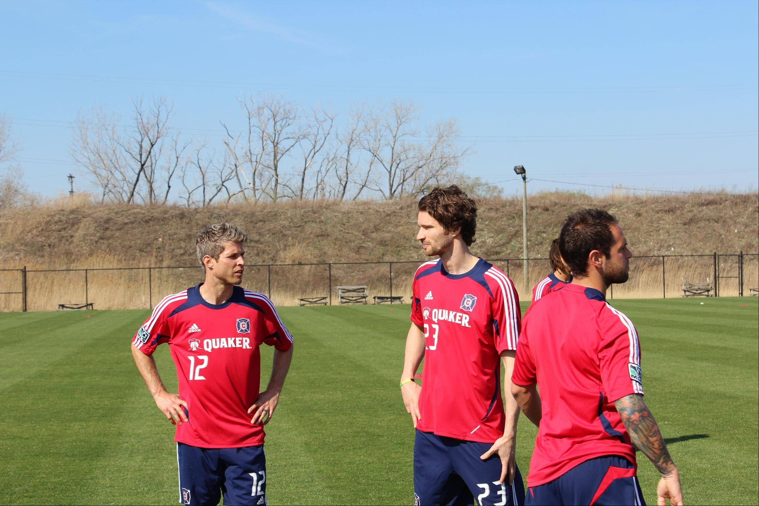 The Fire's Logan Pause, left, and German defender Arne Friedrich, center, get to know each other at practice Tuesday. Friedrich said former teammate Pavel Pardo only had good things to say about the club and playing in Chicago.