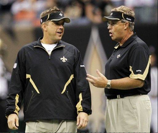 In this Sept. 26, 2010 photo, New Orleans Saints head coach Sean Payton and defensive coordinator Gregg Williams during their NFL football game at the Louisiana Superdome in New Orleans, La.