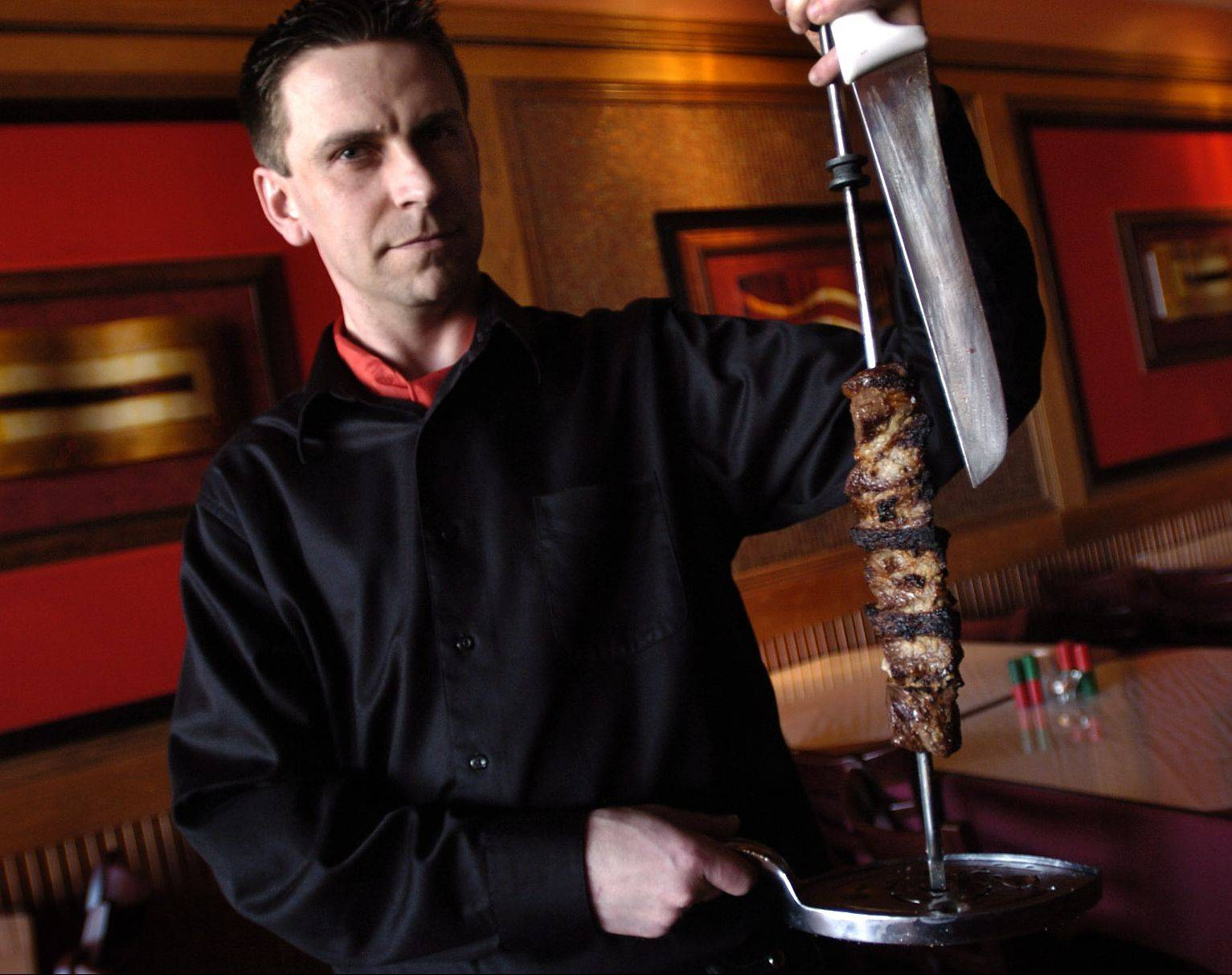 Gaucho Paulo Derkascz presents garlic steak at Sake & Samba Brazilian Churrascaria in Vernon Hills.