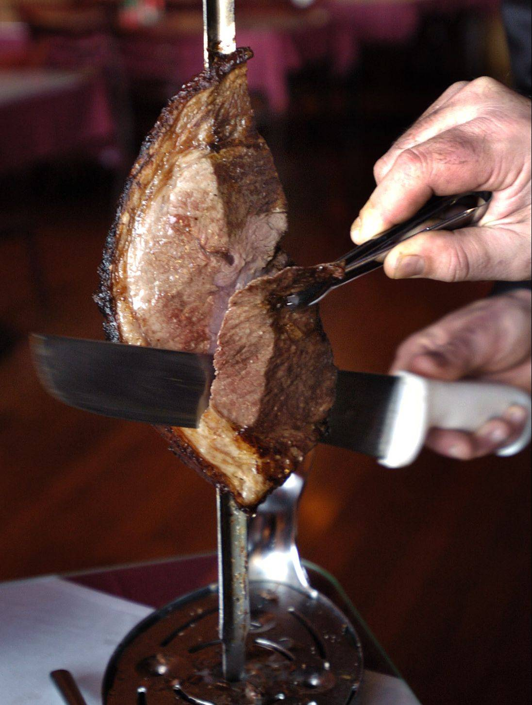 Gauchos slice top sirloin, or alcatra, and other meats tableside at Sake & Samba Brazilian Churrascaria.
