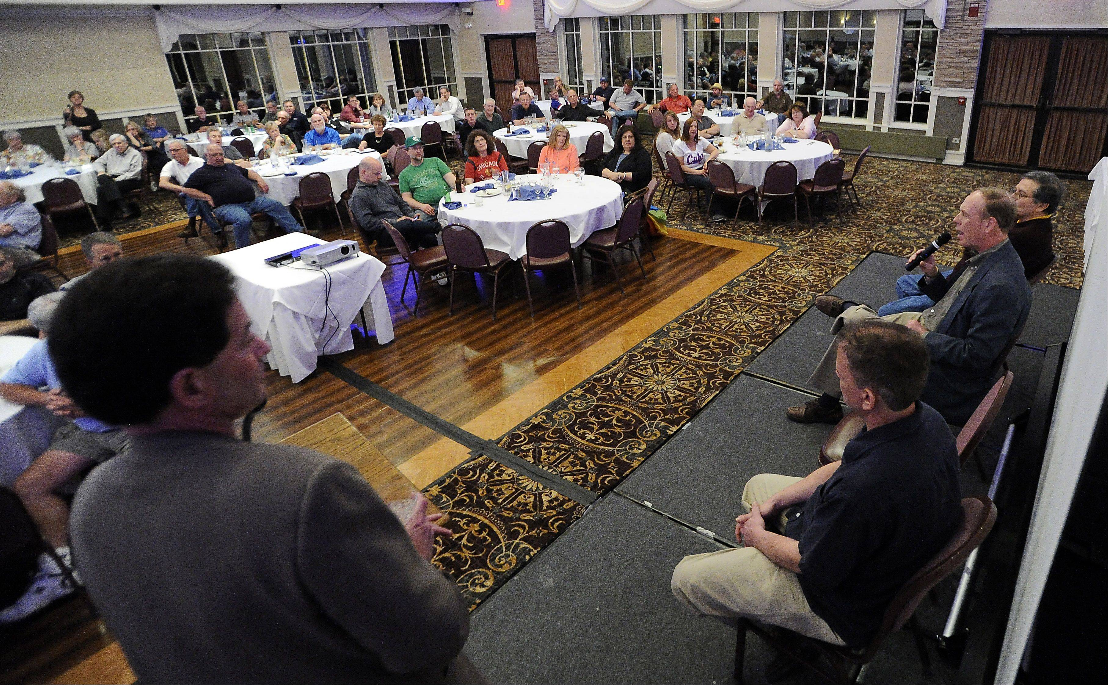 "Cubs beat writer Bruce Miles fields a question from an audience member at the ""Ask the Sportswriters"" event sponsored by the Daily Herald in Schaumburg on Thursday."