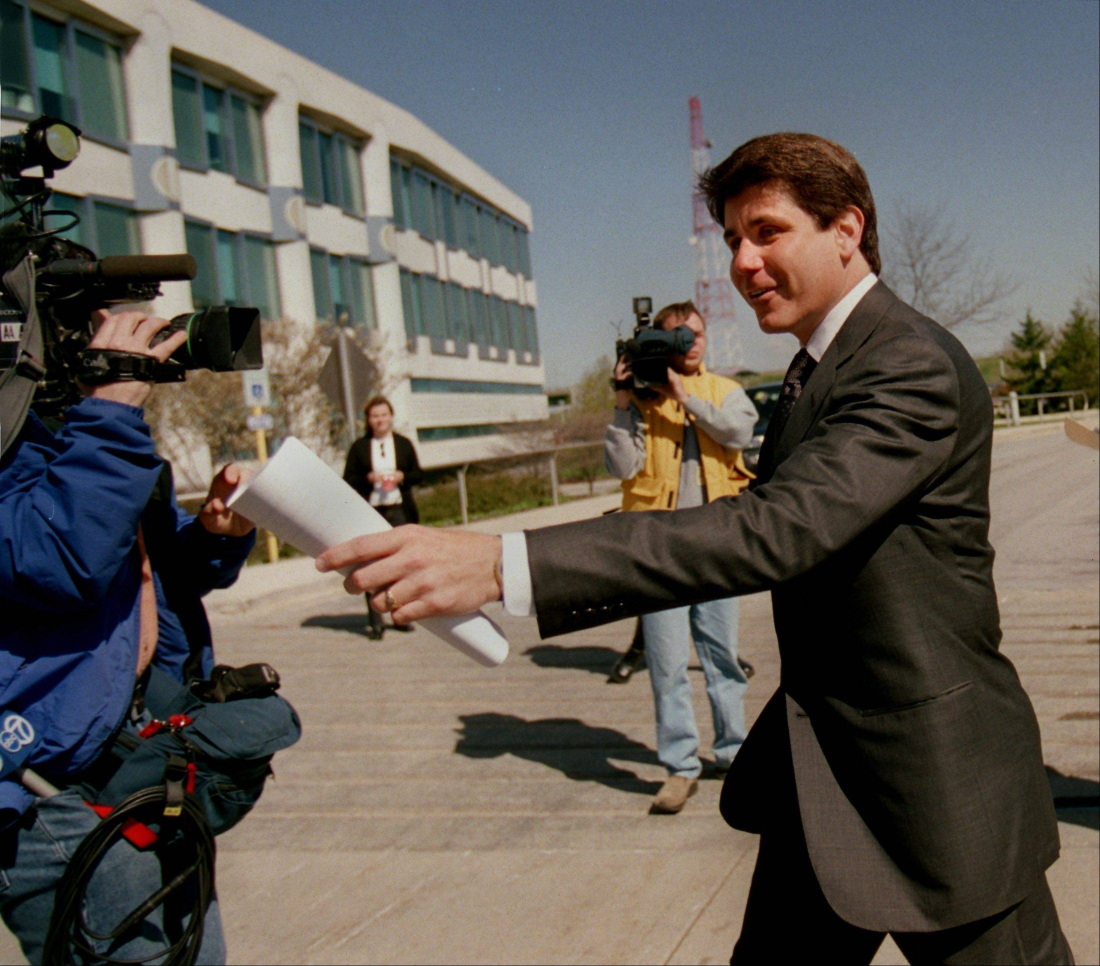 Ex-Gov. Rod Blagojevich, shown outside the Illinois Tollway Authority headquarters in Downers Grove, initiated fund transfers from the toll authority to the state's general fund, an inspector general's report says.