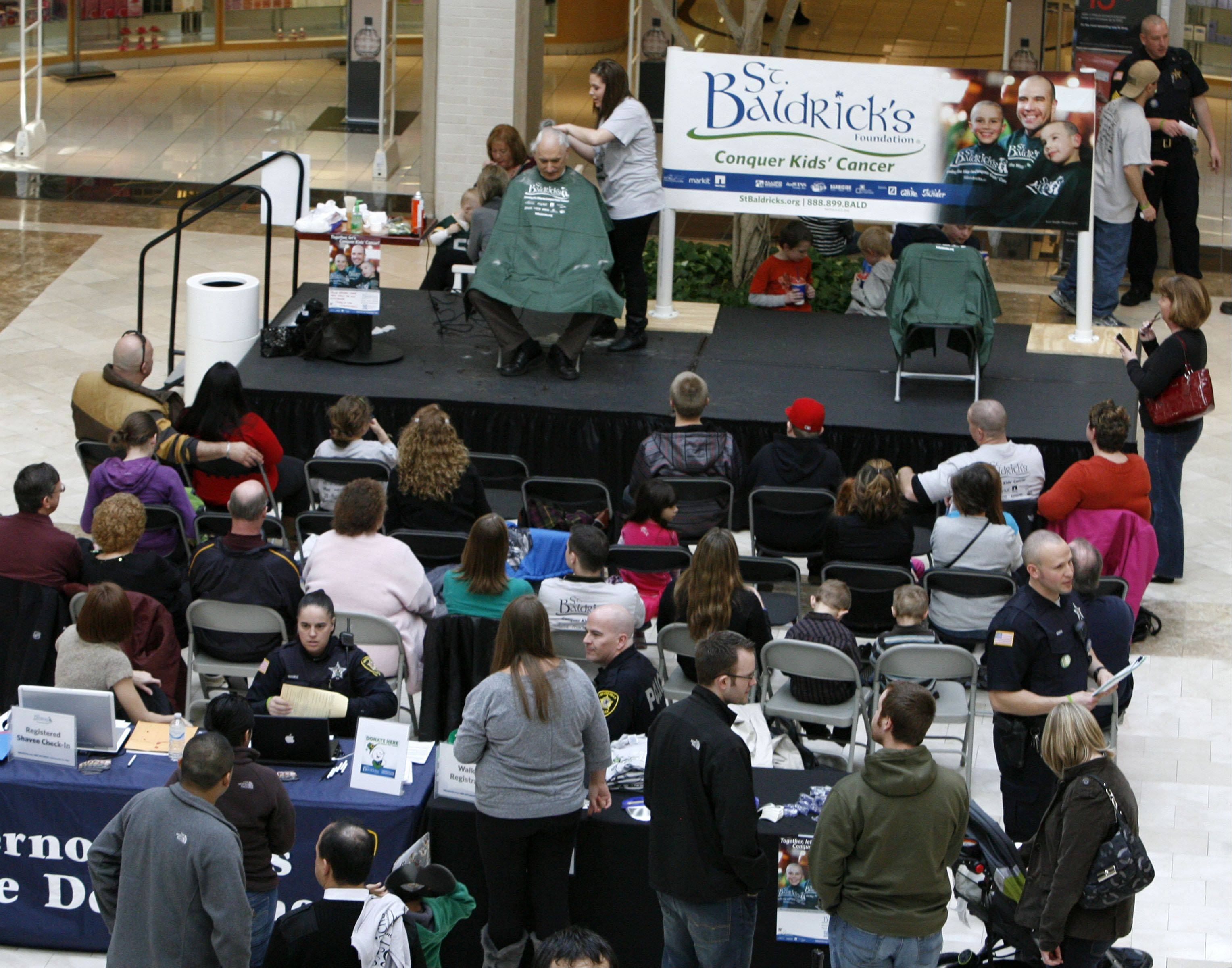 About 200 attended as Vernon Hills Police officers volunteered to have their heads shaved during the Vernon Hills St. Baldrick�s event to raise money to fight childhood cancer held at Westfield Hawthorn Mall in Vernon Hills on Saturday, March 10th.