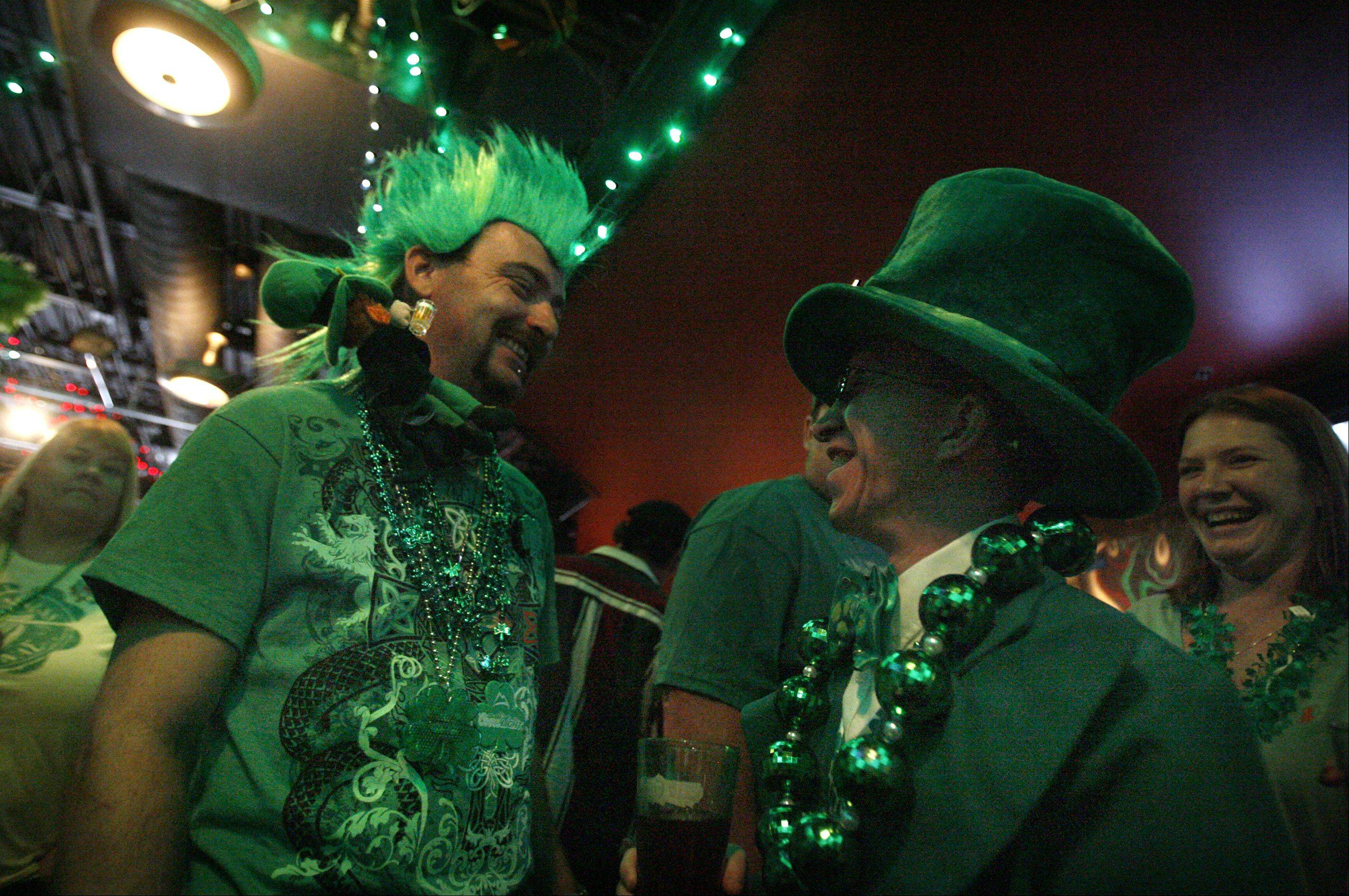 James Whitaker of Libertyville, left, and Pierce Coleman of Antioch have a laugh while waiting for a late start to the St. Patrick's day St. Baldrick's event at Mickey Finn's in Libertyville on Saturday, March 17th.