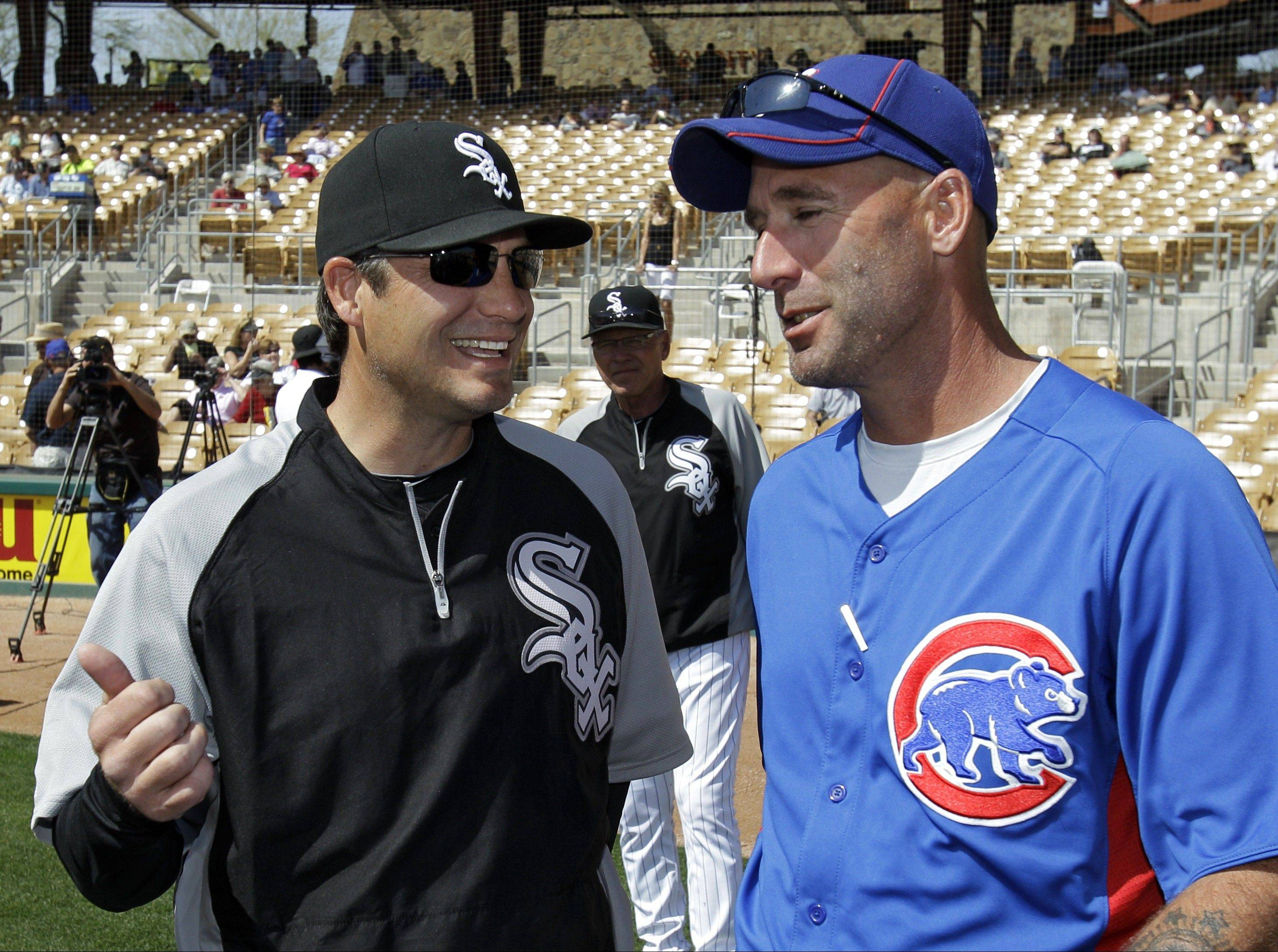 New White Sox manager Robin Ventura, left, compares notes with first-year Cubs manager Dale Sveum in spring training.