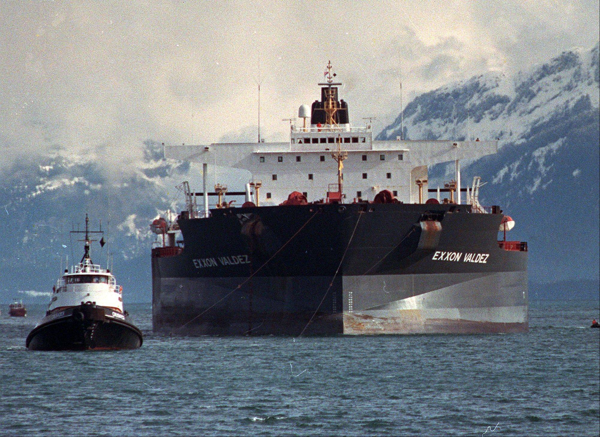 Tugboats pull the crippled tanker Exxon Valdez towards Naked Island in Prince William Sound, Alaska, in this April 5, 1989, file photo after the ship was pulled from Bligh Reef.