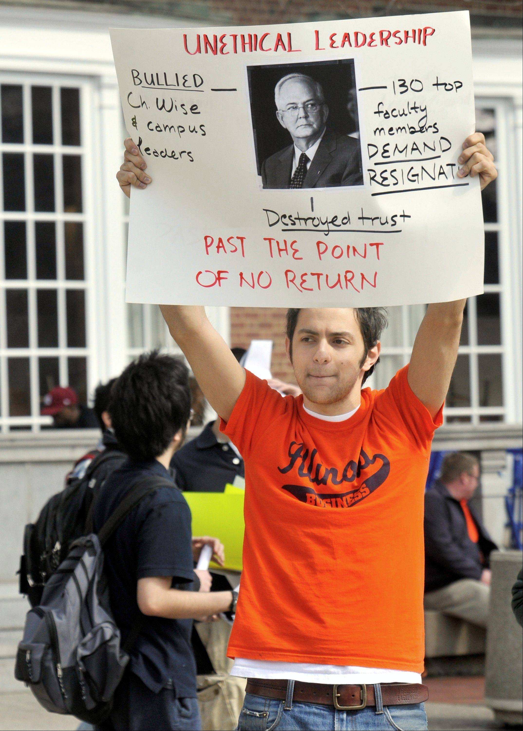 Keenan Kassar, president of Students for a Better Illinois, protests University of Illinois President Michael Hogan and his former chief of staff, Lisa Troyer, on March 12 in Urbana.