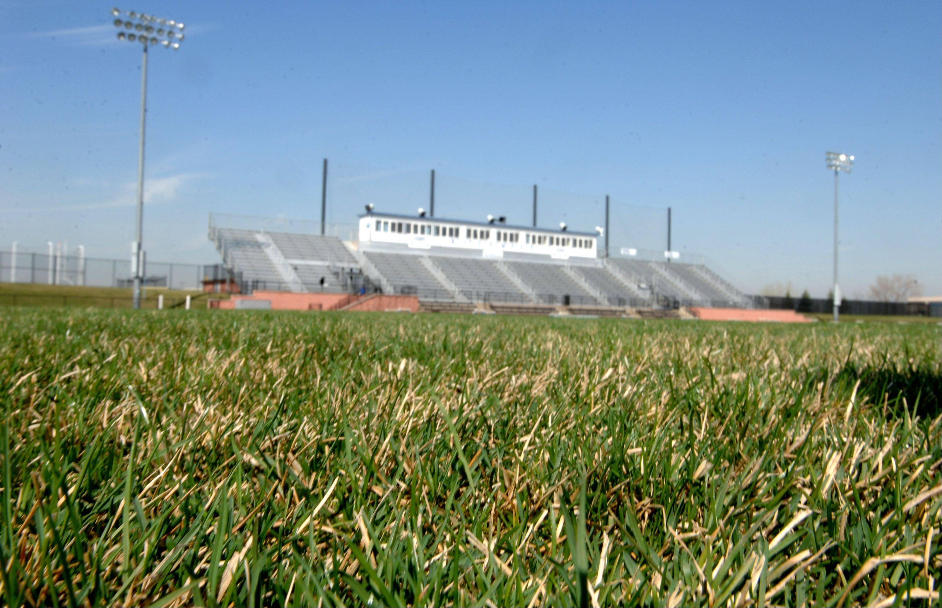 The grass football field at Vernon Hills High School will be replaced with artificial turf, Libertyville-Vernon Hills Area High School District 128 announced this week.