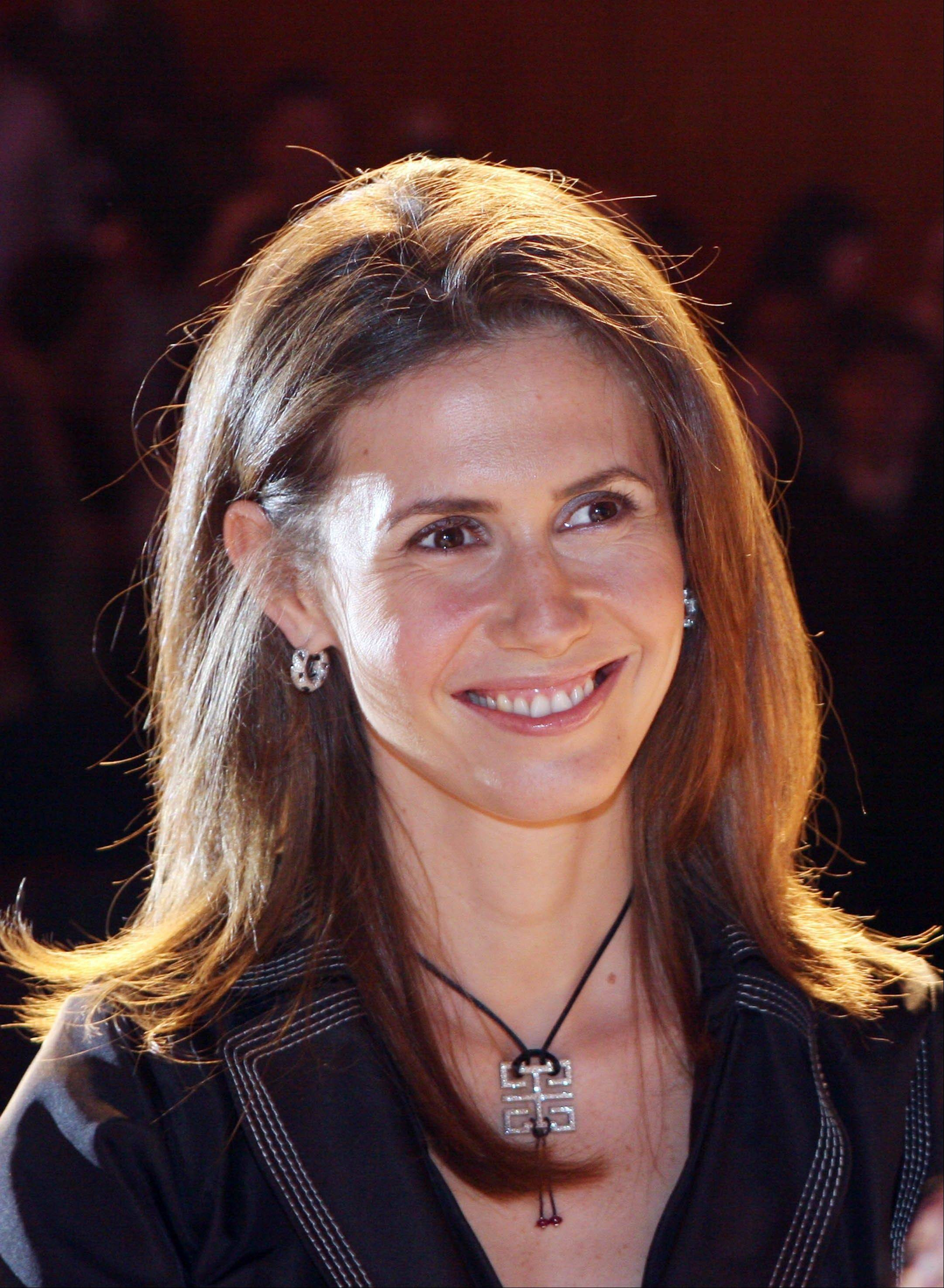 Asma Assad, the wife of Syrian President Bashar Assad, poses for the camera on in this May 20, 2007 file photo. An EU official said Thursday March 23, 2012, a total of four members of the Assad family, along with eight government ministers, will be targeted in the latest round of sanctions aimed at stopping the violent crackdown on members of the Syrian opposition.
