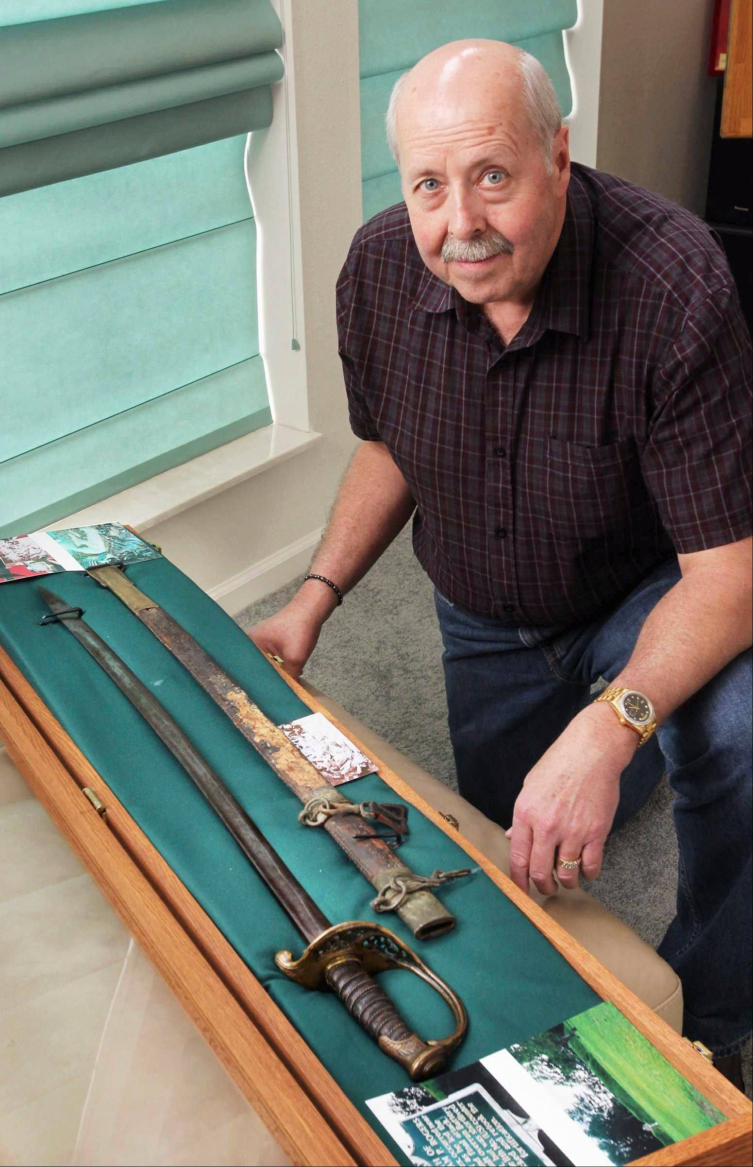 Allen Wandling, of Belleville, Ill., with Confederate Col. William P. Rogers sword from the Battle of Corinth, Miss. Wandling, a serious Civil War memorabilia collector, bought the sword from a man in Joplin, Mo., and spent four years tracing the story of the sword.