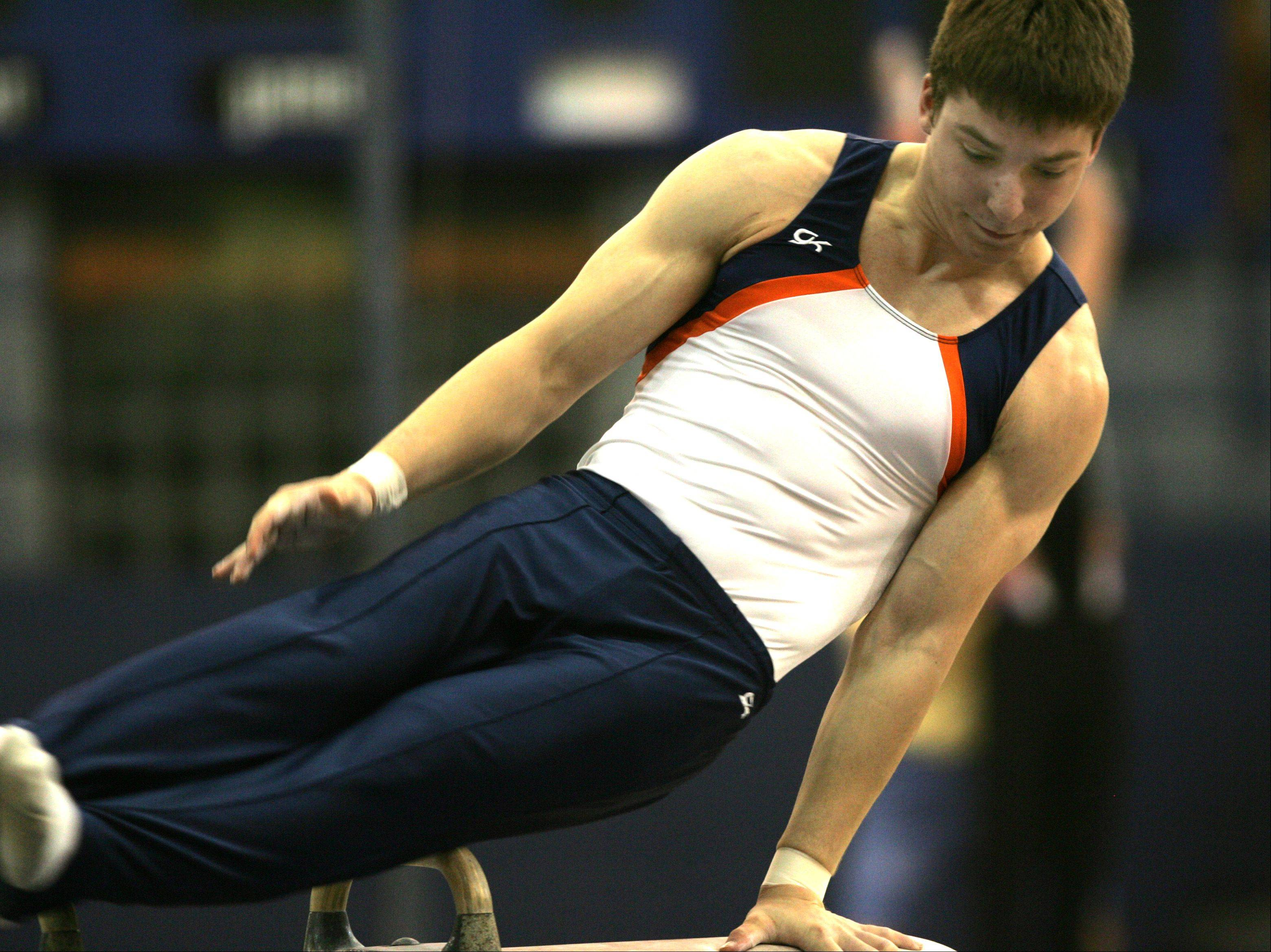 Naperville North's Billy Suta performs his pommel horse routine, during the Ralph Krupke Boys Gymnastics Invitational at Lake Park East High School.