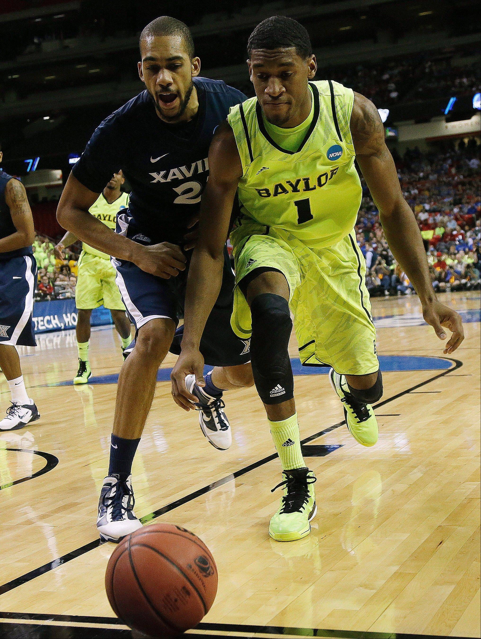 Xavier's Jeff Robinson and Baylor's Perry Jones III battle for a loose ball Friday during a NCAA tournament South Regional semifinal game in Atlanta.