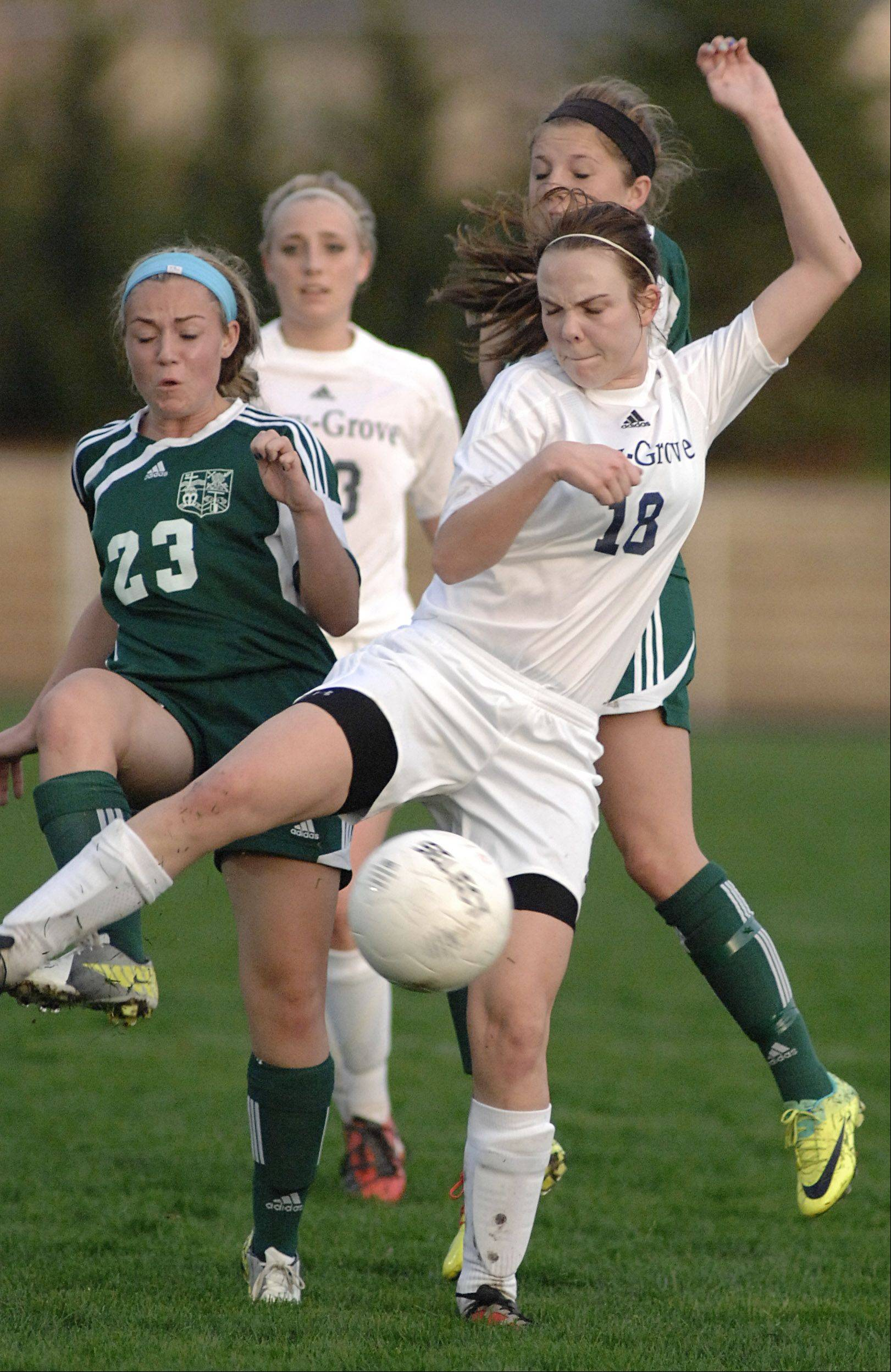 Rockford Boylan's Emma Krahmer, left, and teammate Abby Reed rush the ball for possession and collide with Cary-Grove's Jackie Holtz in the first half on Friday in Cary.