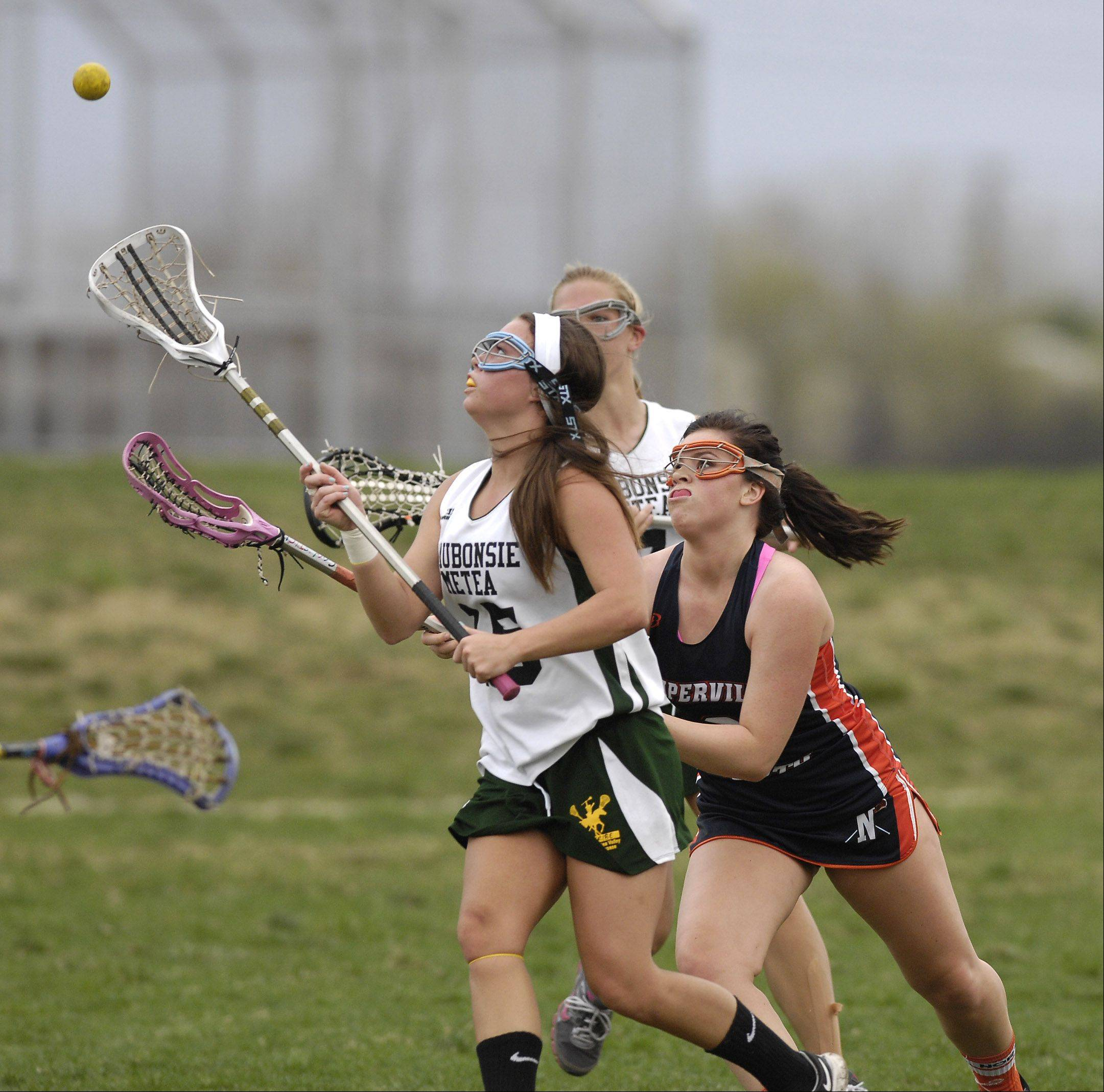 Olivia Javornik Waubonsie/Metea Valley and Izzy Kane of Naperville North battle for the ball during girls lacrosse Thursday in Aurora.