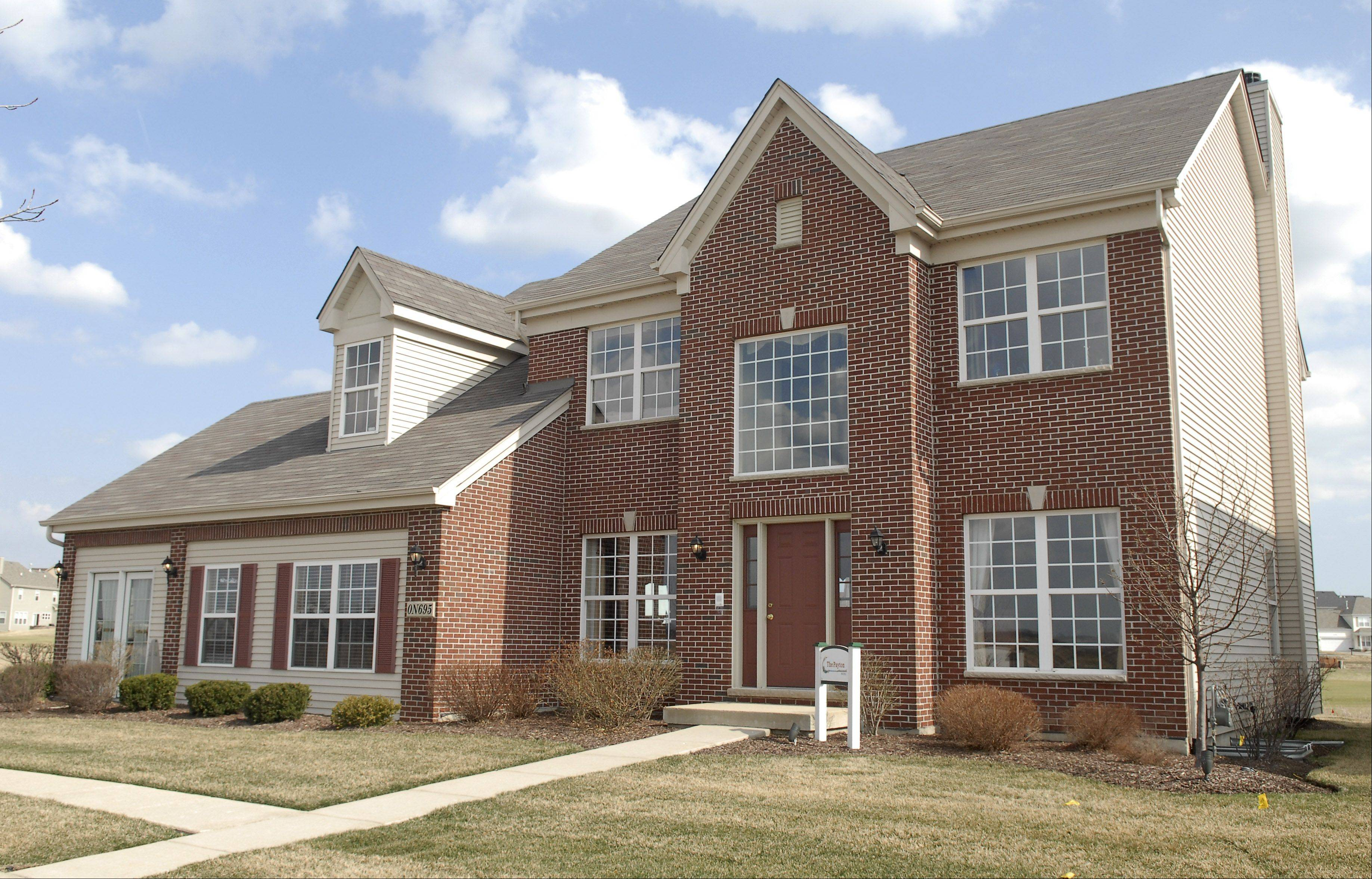 Incentives such as half off options are offered by Shodeen Homes at it's Tanna neighborhood at Mill Creek in Geneva.