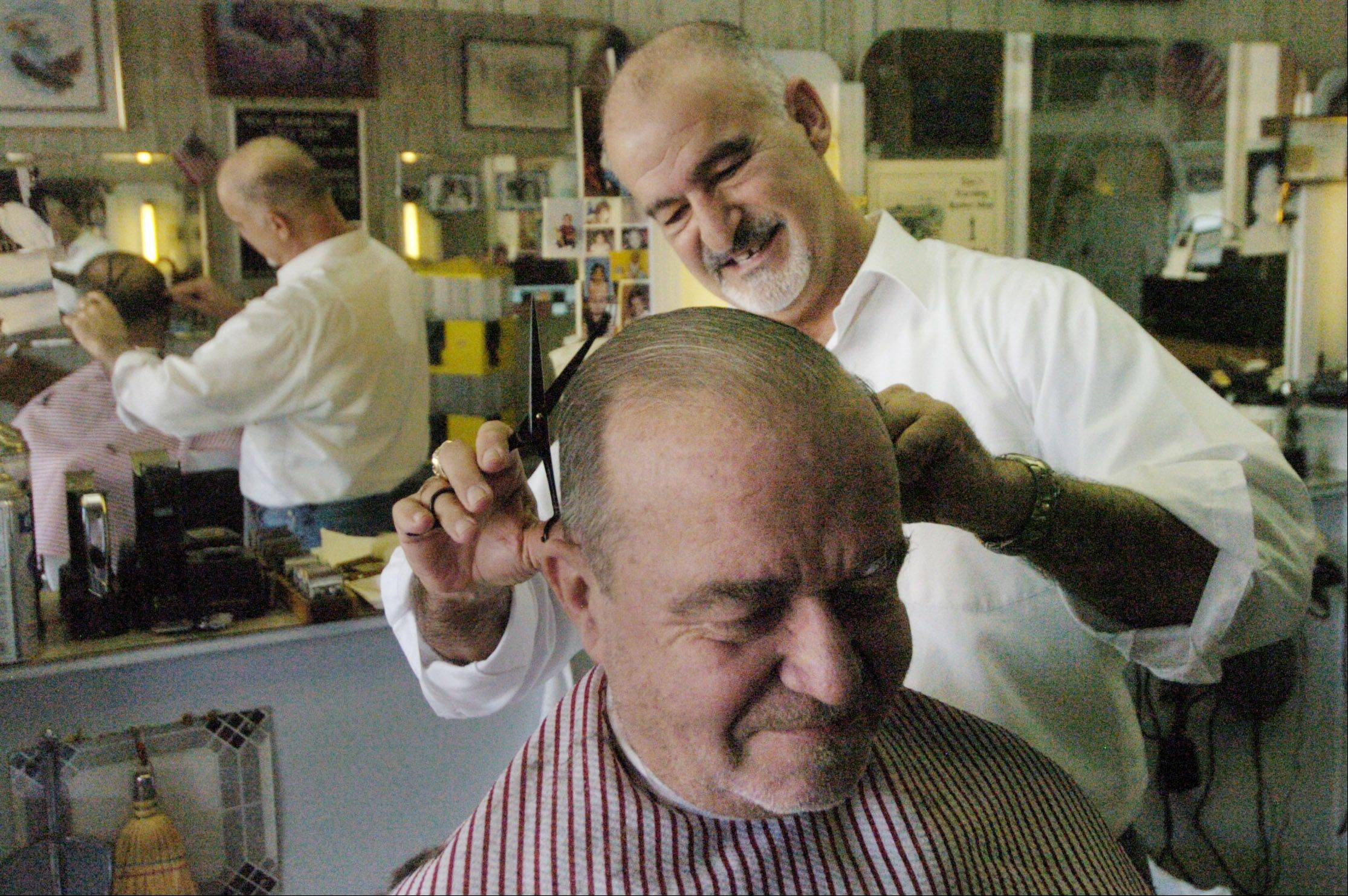 Tony Castelluccio, owner of Tony's Barber Shop in Wauconda, cuts the hair of longtime client Art Billen.