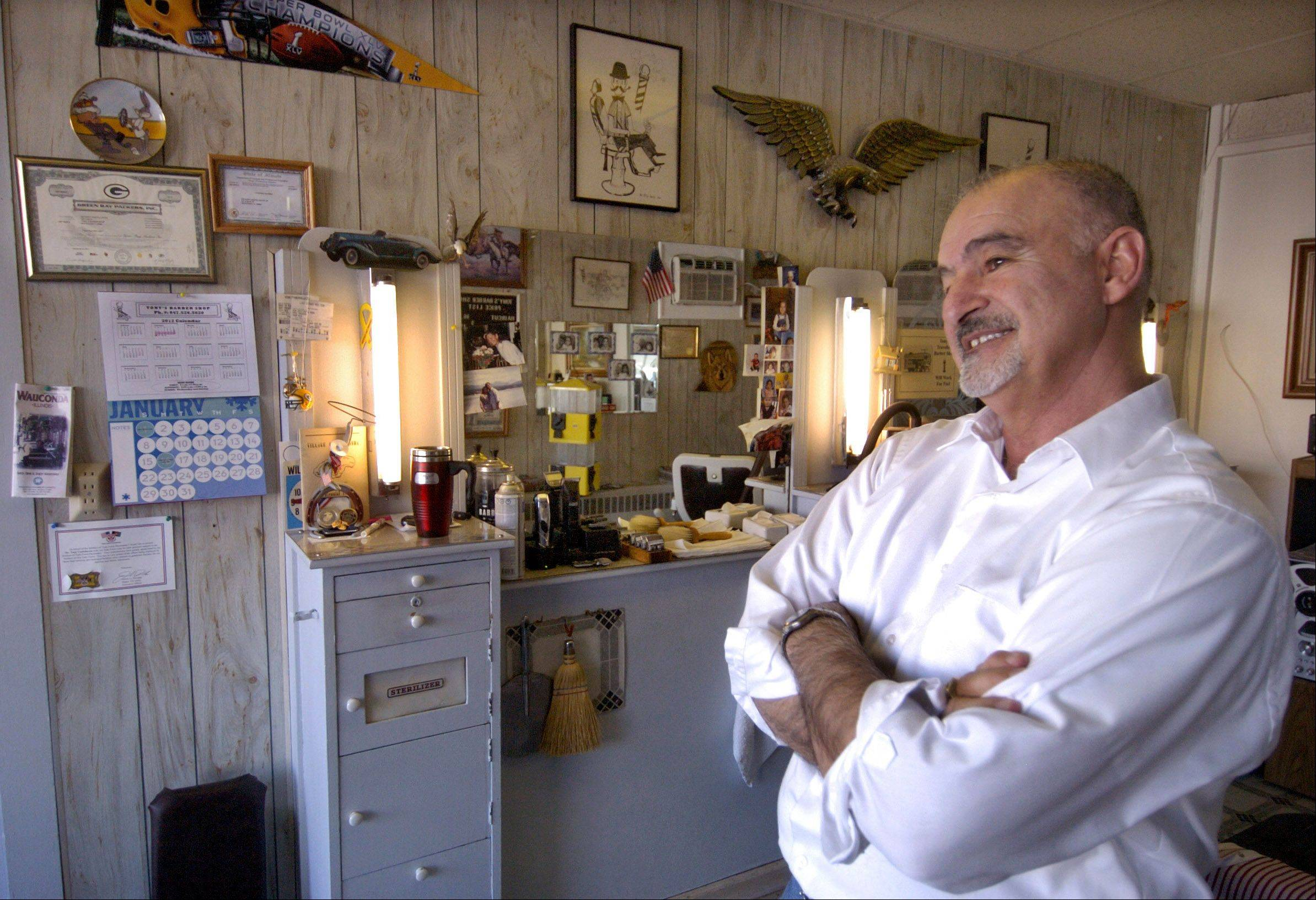 Tony Castelluccio ponders retirement inside his Wauconda barber shop.