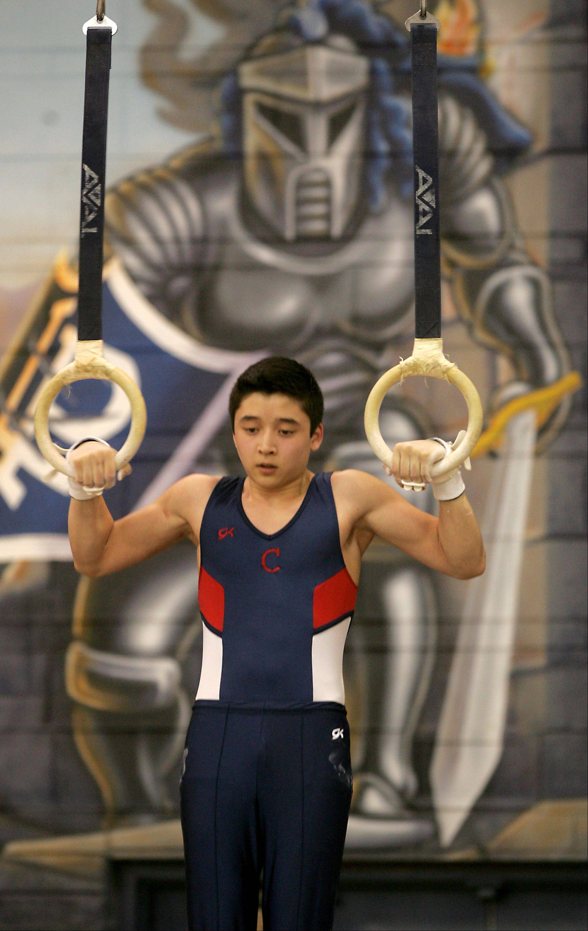 Conant's Brandon Metcalf performs his still rings routine, during the Ralph Krupke Boys Gymnastics Invitational at Lake Park East High School.