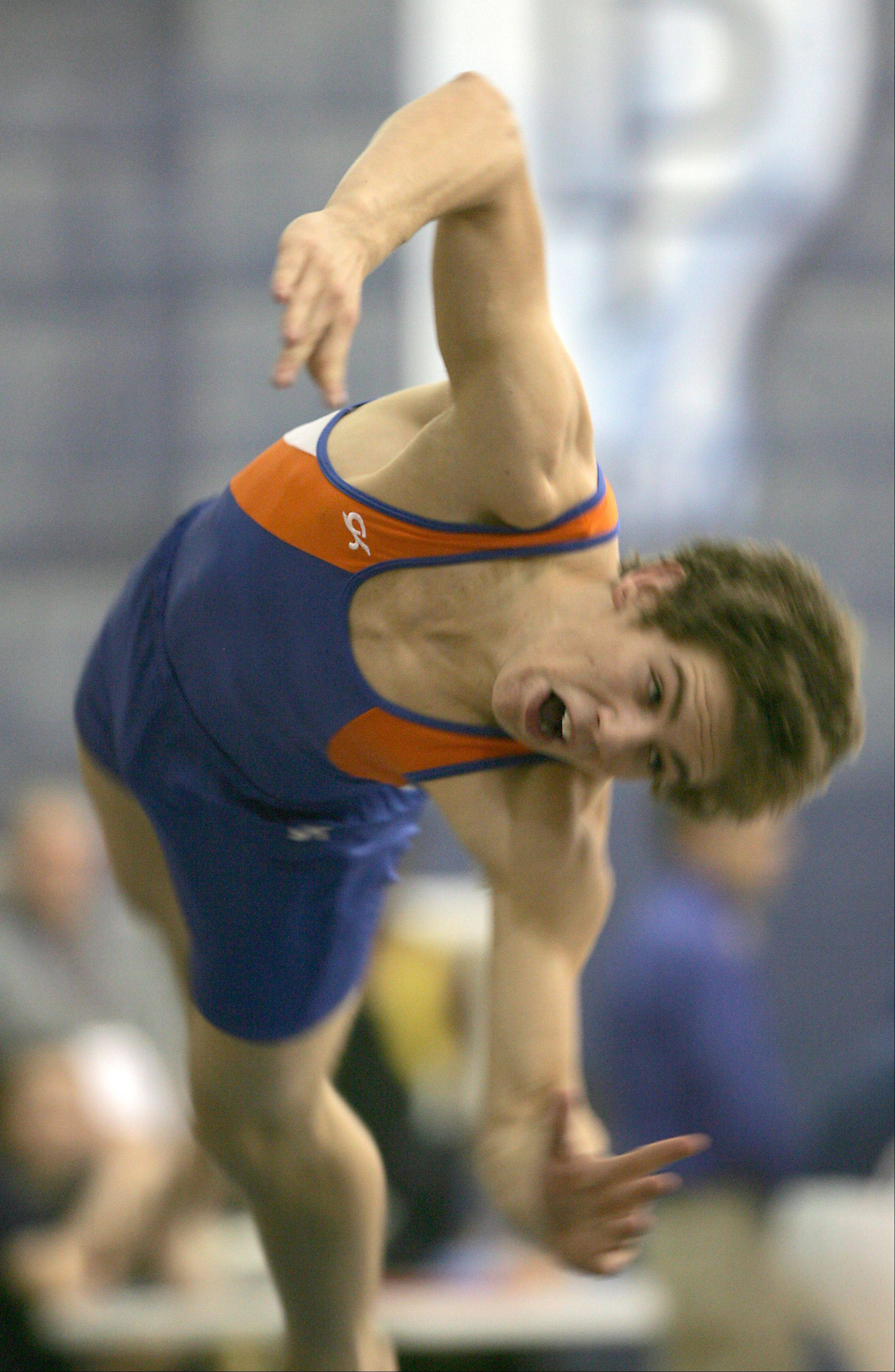 Fenton's Norman Vitellaro performs his floor exercise routine, during the Ralph Krupke Boys Gymnastics Invitational at Lake Park East High School.