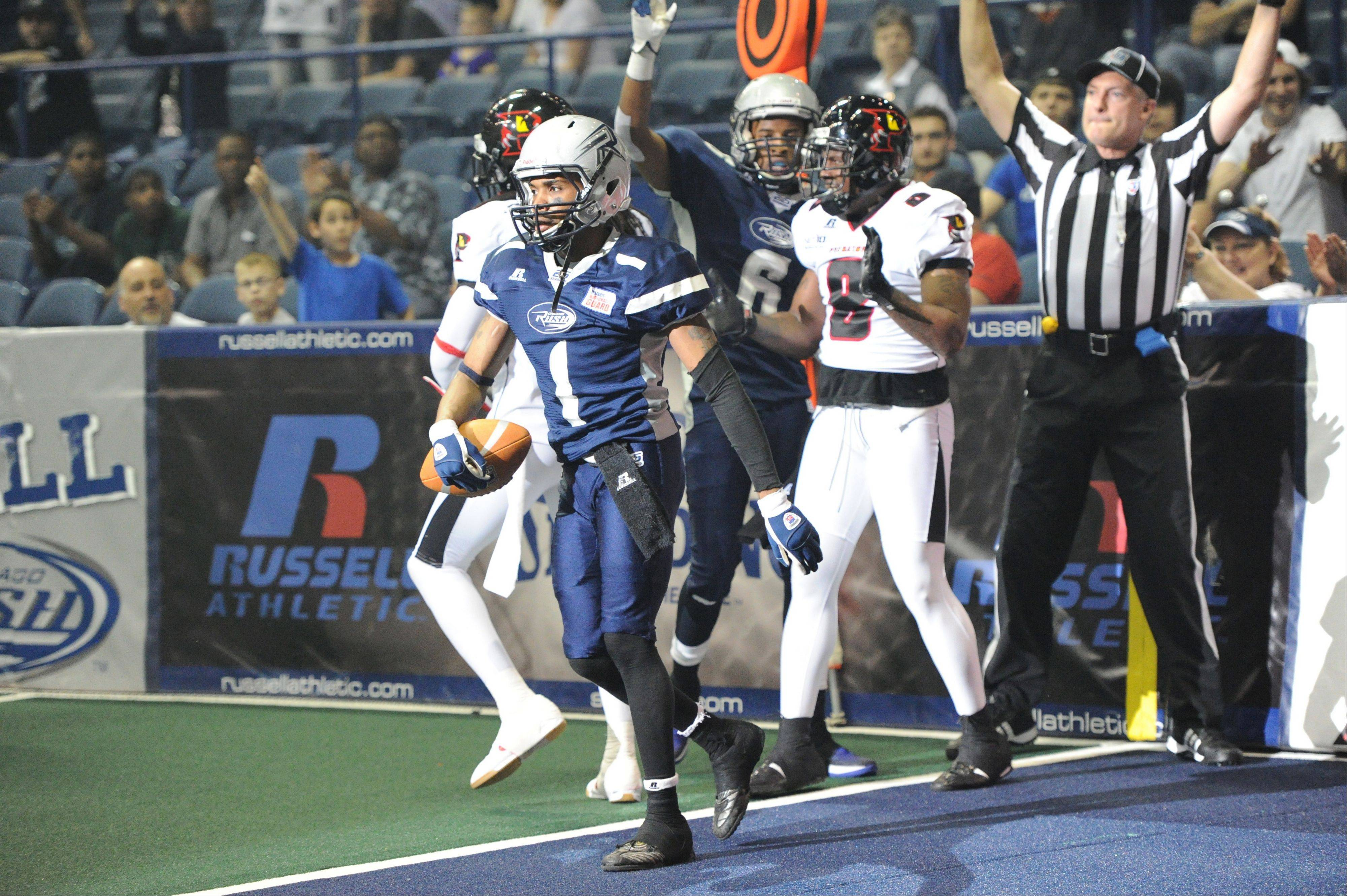Wide receiver Reggie Gray of the Chicago Rush grabbed 5 touchdown passes from quarterback Rush Michna against the Orlando Predators at Allstate Arena Thursday.