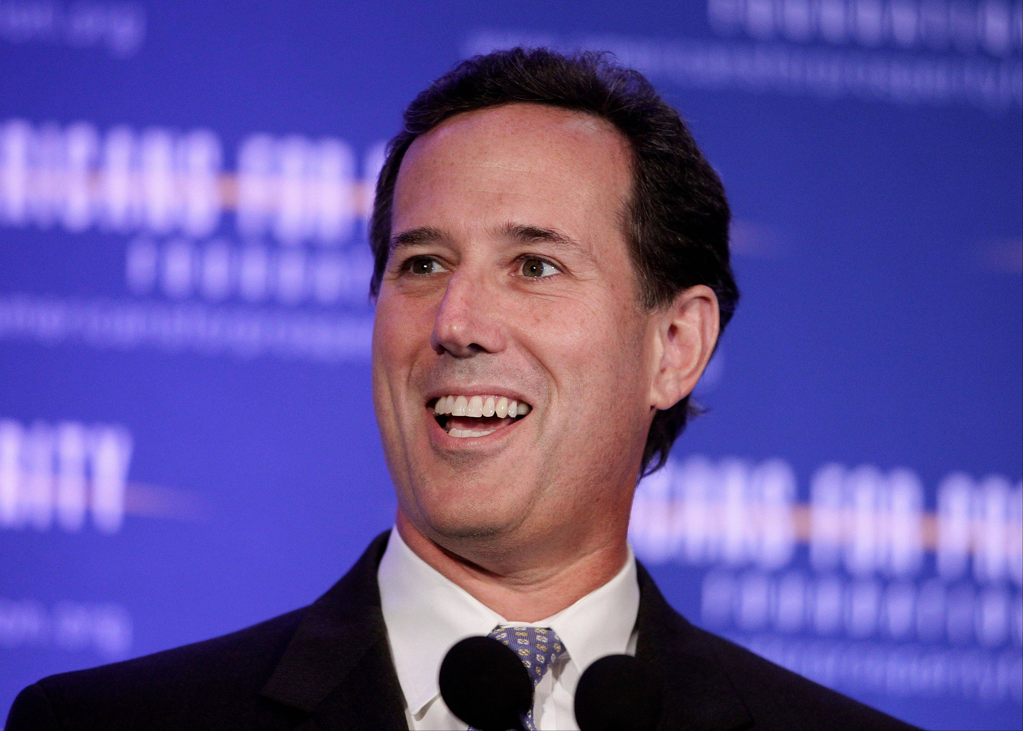 Republican presidential candidate Rick Santorum, a former Pennsylvania senator, speaks Saturday at the AFP Defending the Dream Conference in Milwaukee.