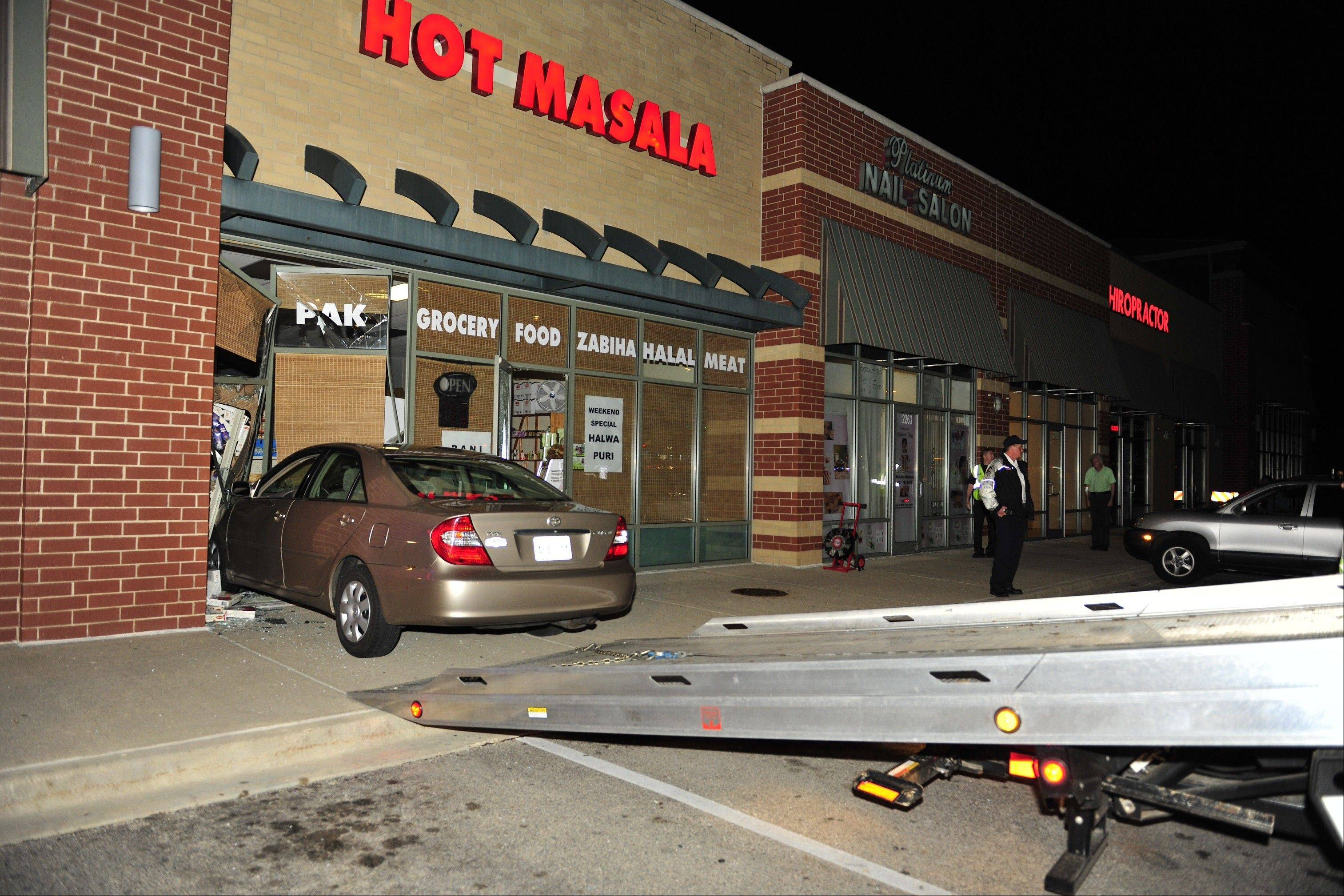 A car crashed into Hot Masala, 2257 Randall Road, on Friday night. The driver was charged with driving under the influence and no injuries were reported.