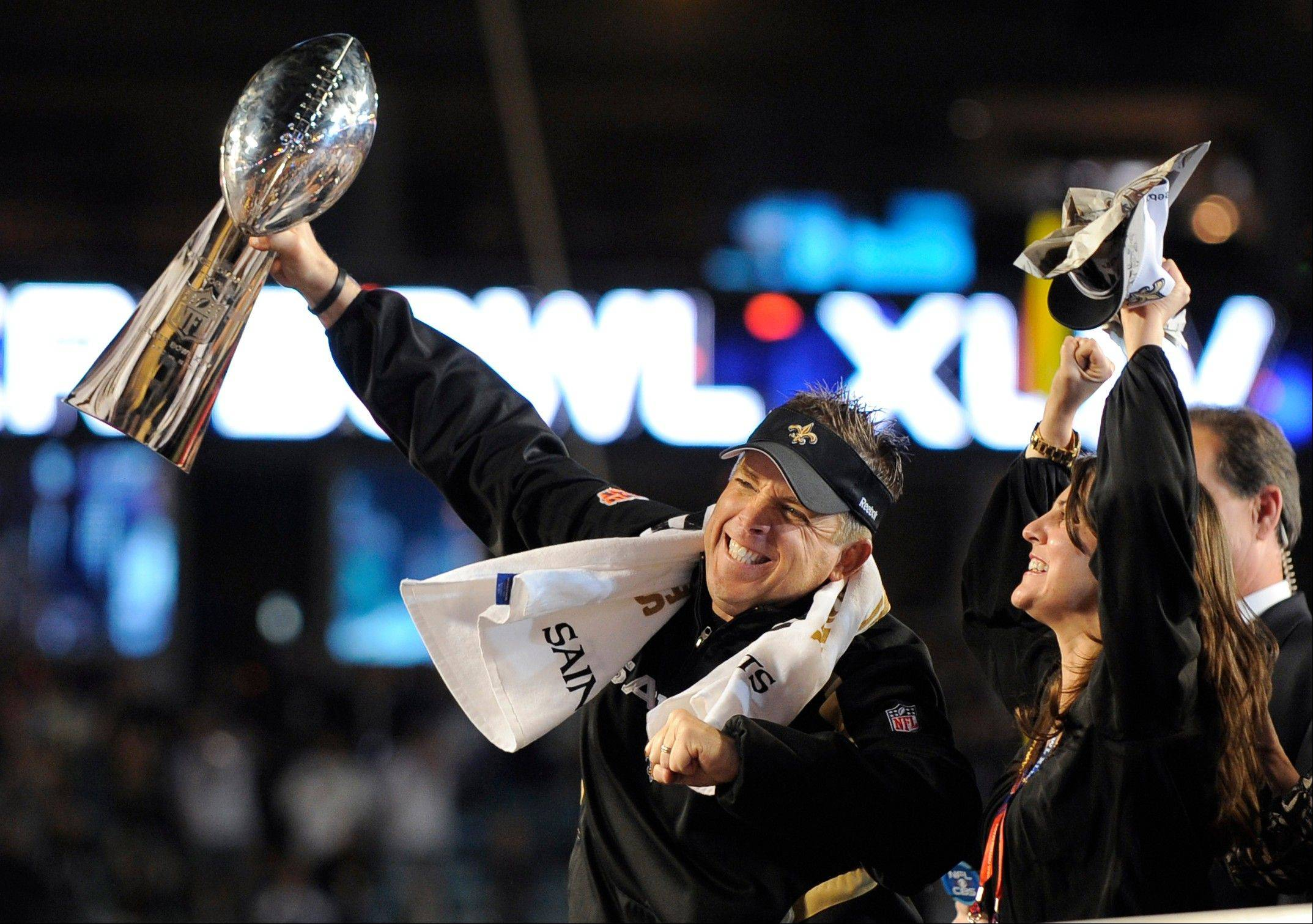 Saints head coach Sean Payton, left, celebrates after winning the NFL Super Bowl XLIV football game in Miami. Saints head coach Sean Payton was suspended without pay for the 2012 season by NFL Commissioner Roger Goodell, and former Saints defensive coordinator Gregg Williams was banned indefinitely on Wednesday, March 21, 2012, because of the team's bounty program that targeted opposing players.