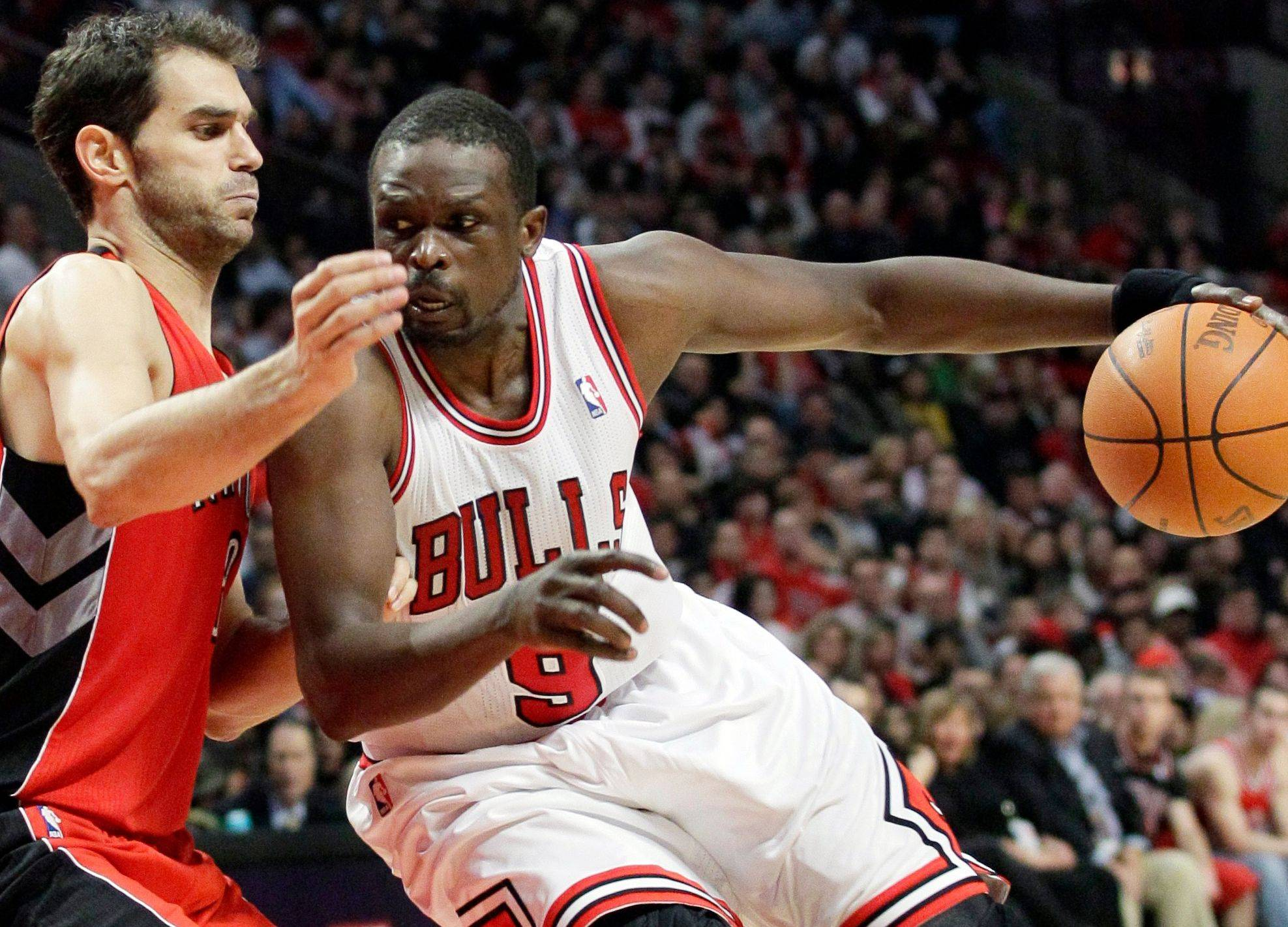 Luol Deng backs down Jose Calderon during the second half of the Bulls' victory Saturday.