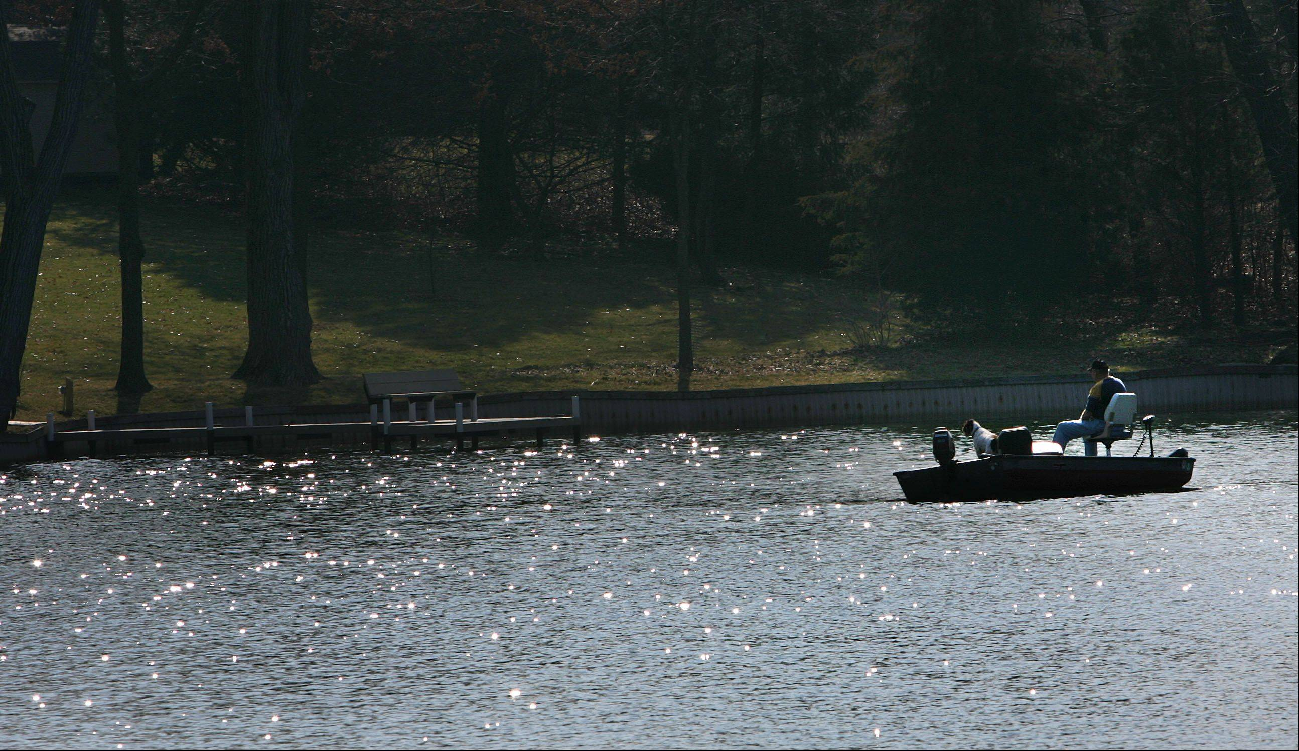 It's not too early in the season for a fisherman to be on Countryside Lake.