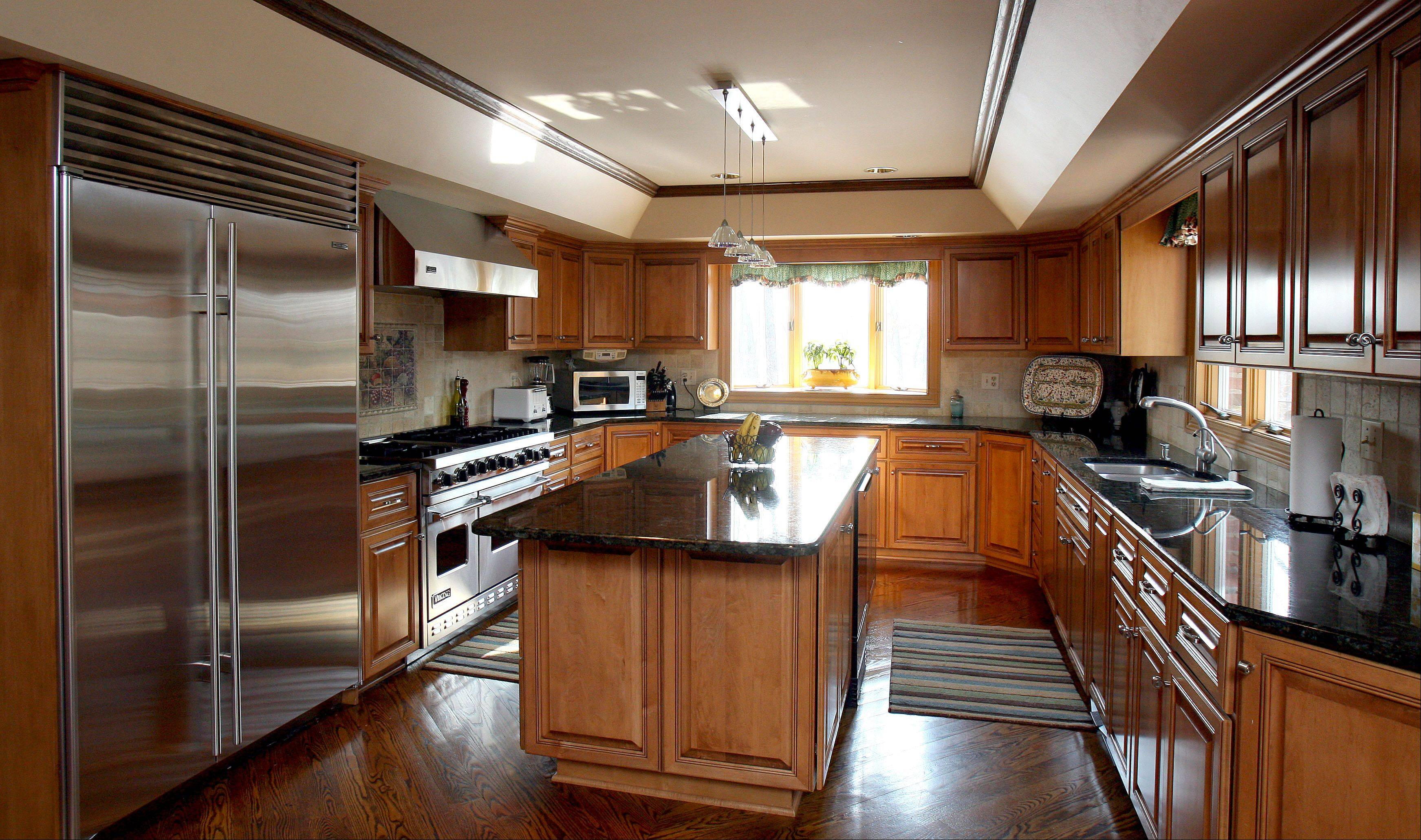 The kitchen of Louise and Tony Sorrentino's home shows maple cabinets, granite countertops and stainless steel appliances.