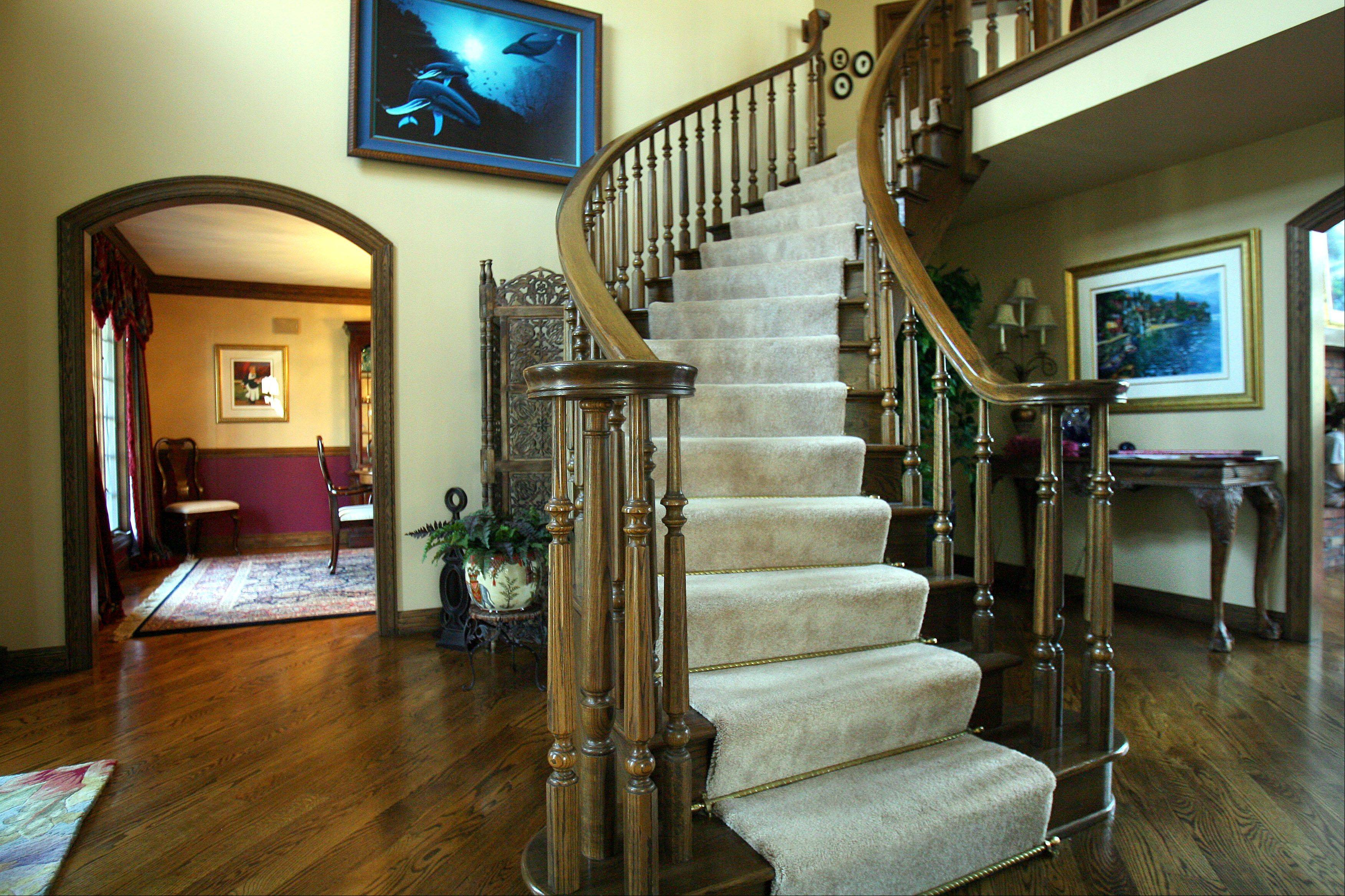 The custom circular staircase is one of the details in Louise and Tony Sorrentino's home in Countryside Lake.