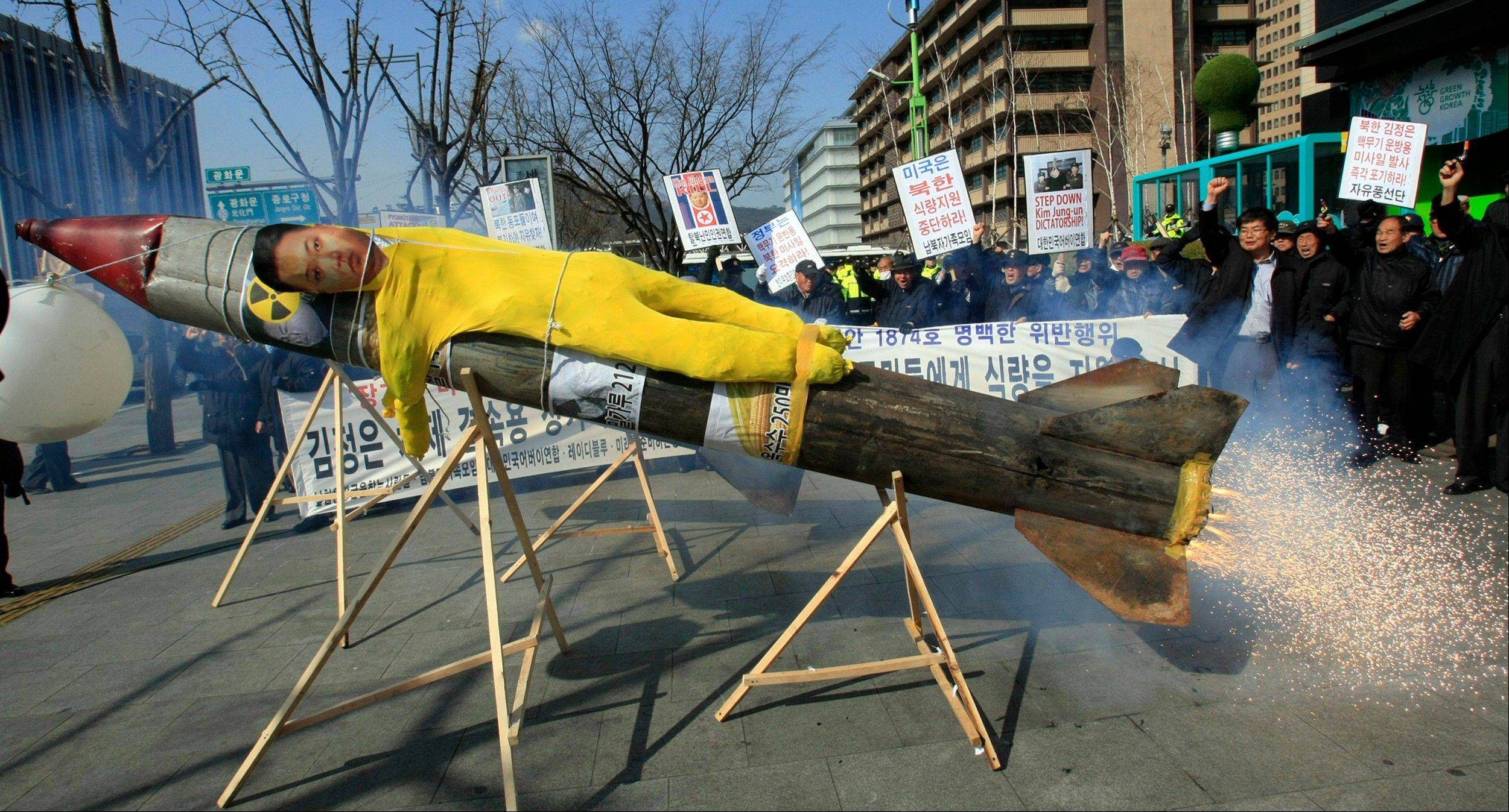 An effigy of North Korean leader Kim Jong Un is put on a mock North Korean missile during an anti-North Korea rally denouncing North's plan to launch a long-range rocket in Seoul, Tuesday, March 20, 2012. North Korea vowed Sunday to go ahead with plans to launch a long-range rocket, rejecting criticism in the West that it would scuttle recent diplomacy.