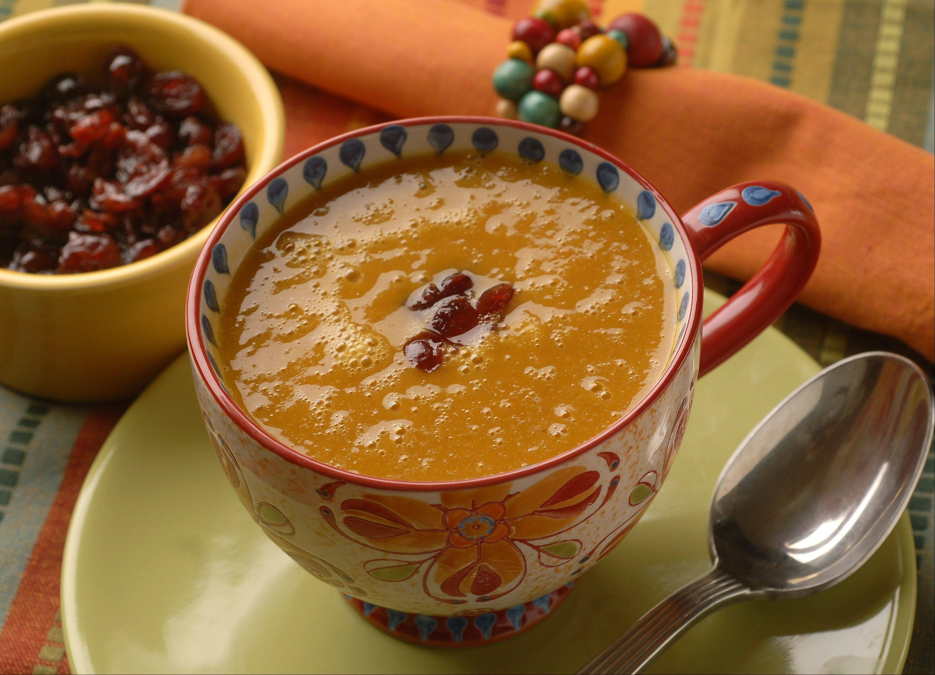 Turn cans of pumpkin leftover from holiday baking into a creamy soup accented by sherry-soaked cranberries.
