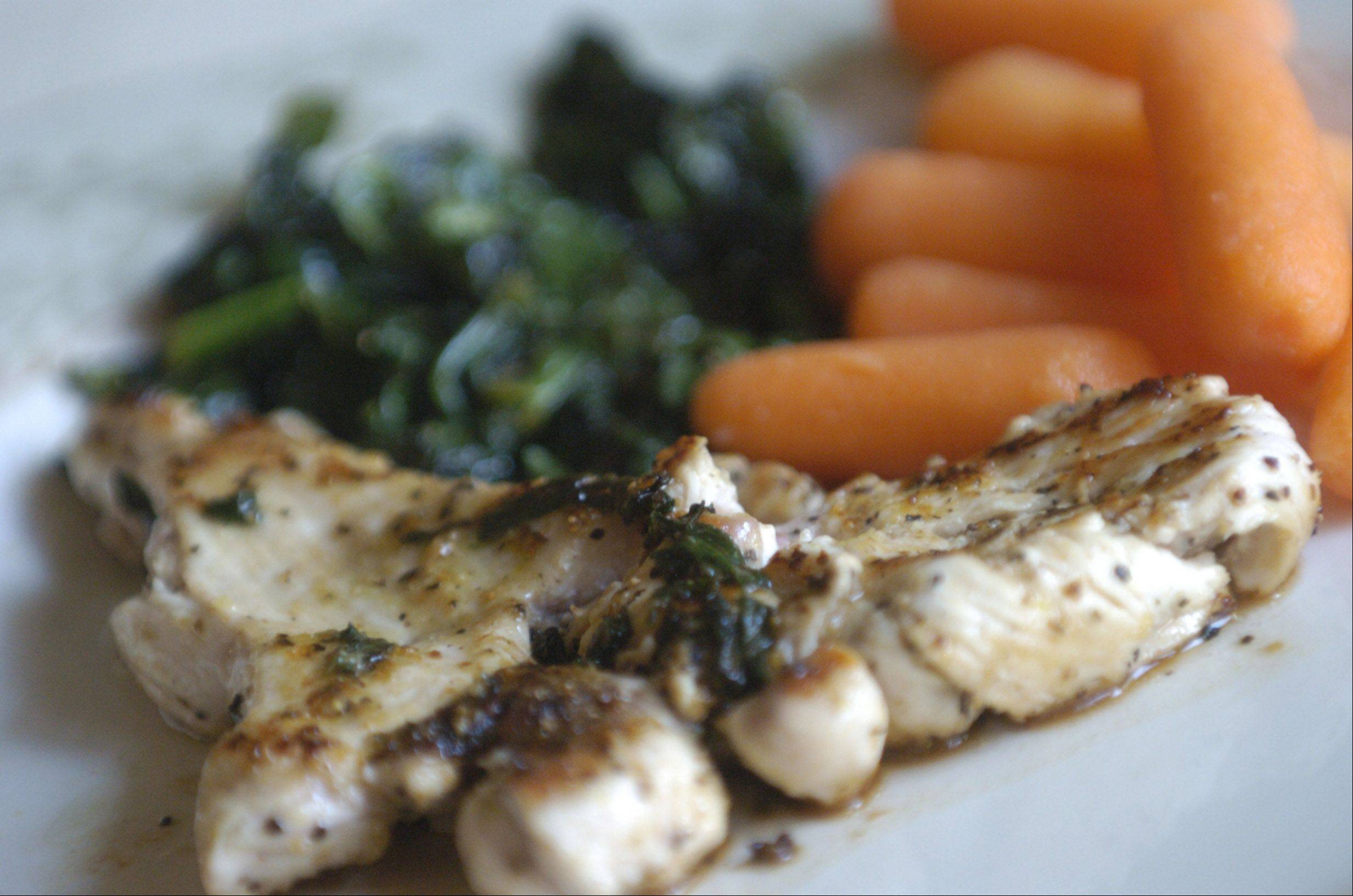 JOE LEWNARD/jlewnard@dailyherald.comTom Hampson's healthy lunch features a chicken breast served with spinach and baby carrots.