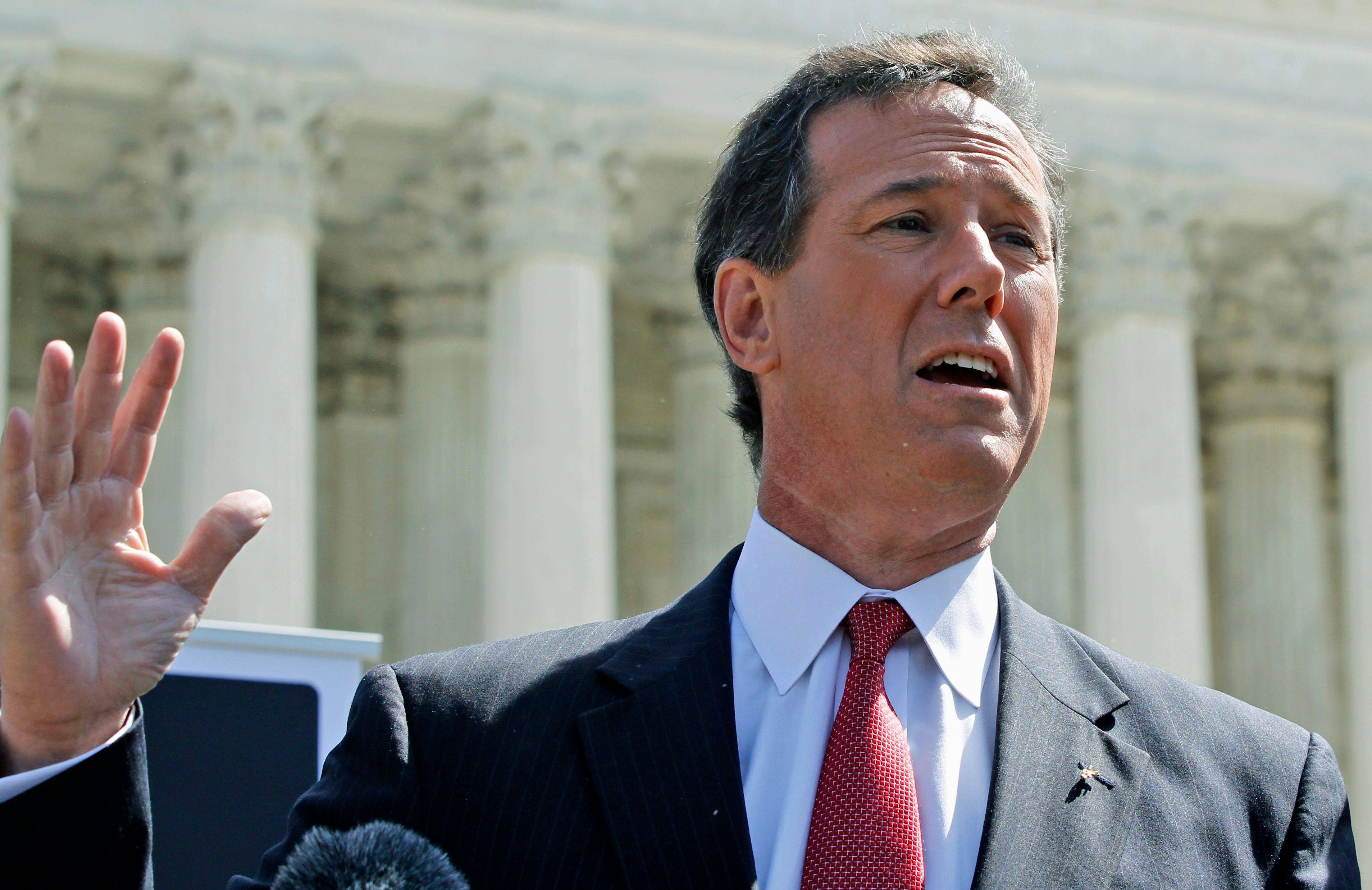 Republican presidential candidate, former Pennsylvania Sen. Rick Santorum speaks in front of the Supreme Court in Washington Monday, as the court began three days of arguments on the health care law signed by President Barack Obama.