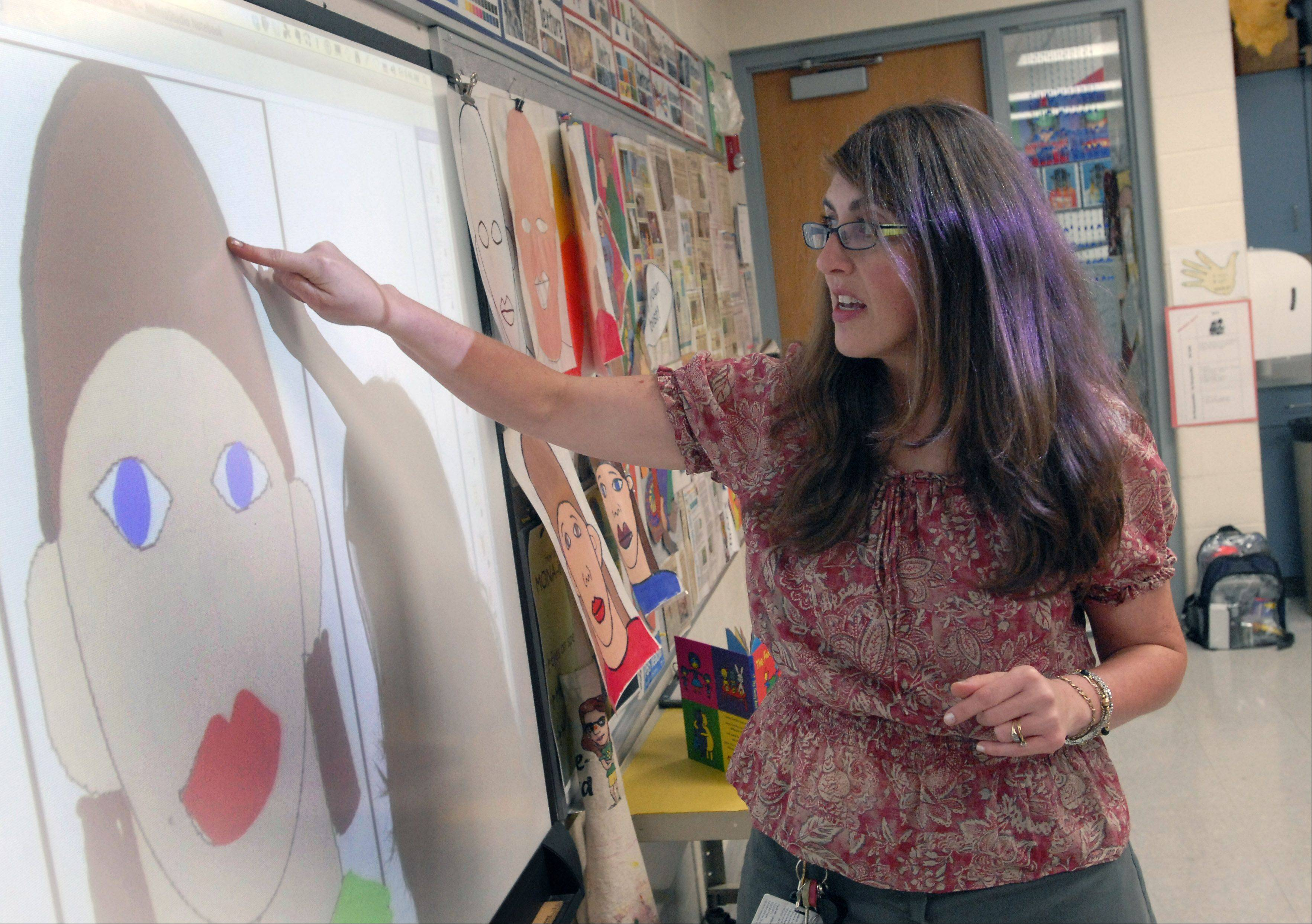 Golden Apple finalist Tricia Fuglestad teaches kindergartners how to do self-portraits at Dryden School in Arlington Heights.