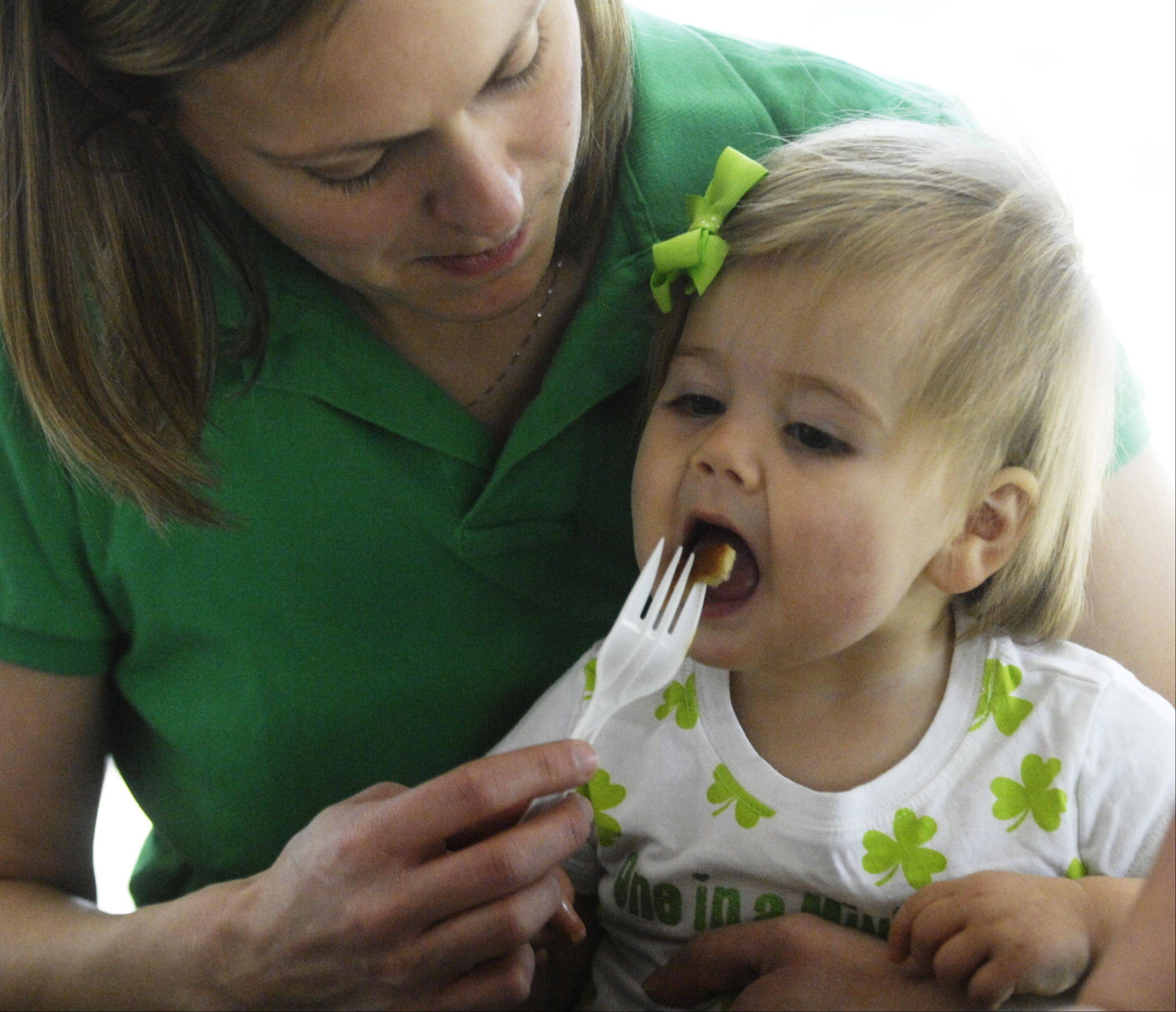Zoe Anaya, 1, of Rolling Meadows enjoys a plate of pancakes and syrup with her mom, Nicole, during the Sugar Bush Festival at the Spring Valley Nature Center in Schaumburg Saturday.