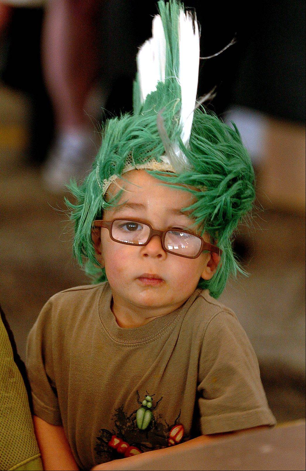 2-year-old Beau Rhodes of Barrington, wears a uniquely Irish headdress on the first day of St. Patrick's-themed Barrington Celtic Fest.