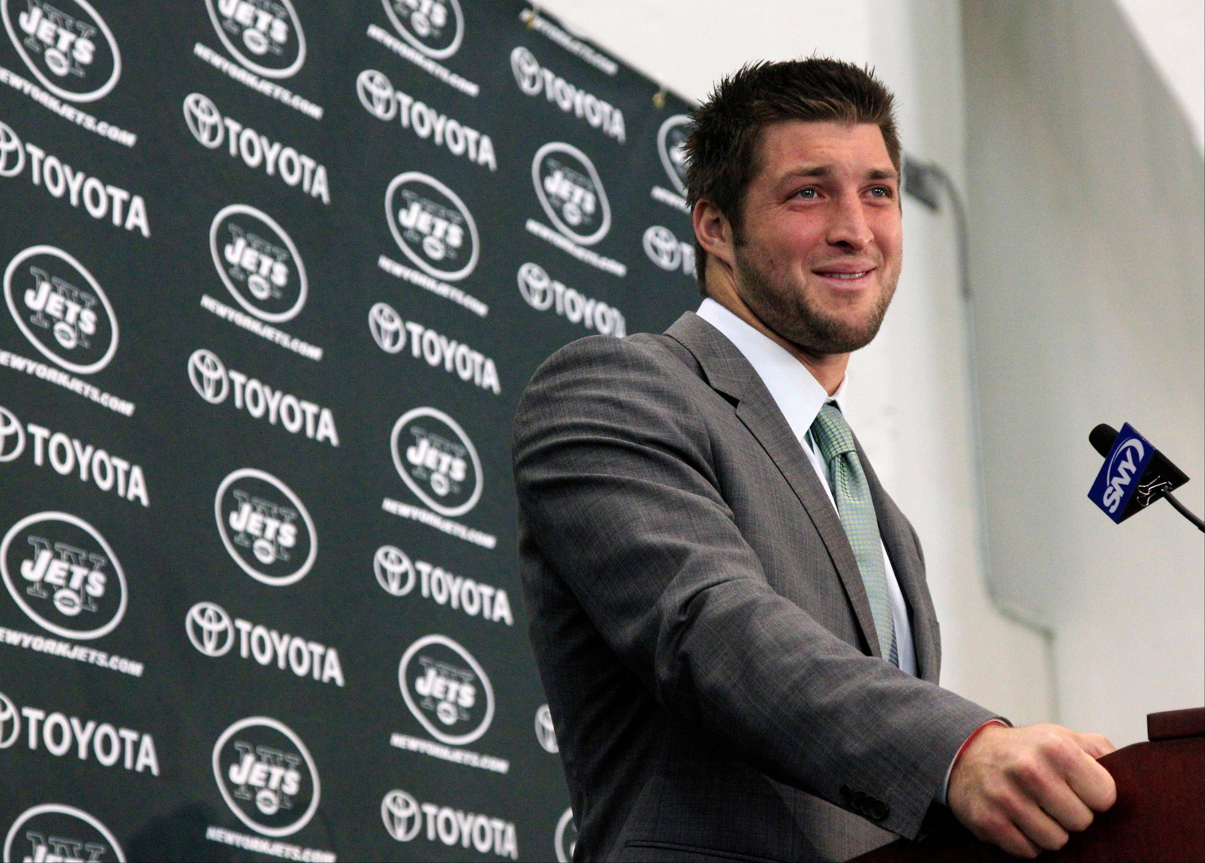 Tim Tebow holds his first news conference with the New York Jets, in Florham Park, N.J., Monday.
