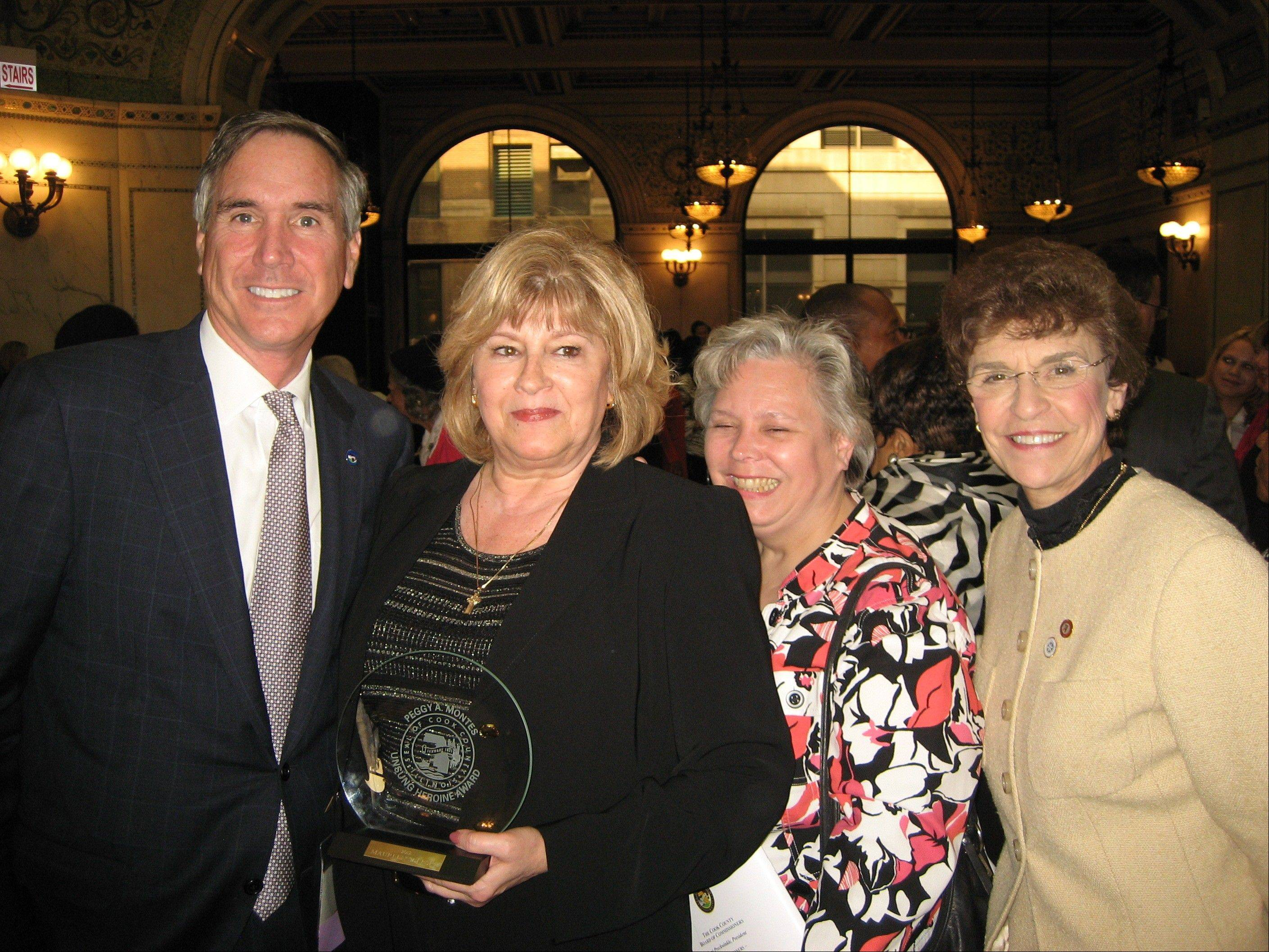 Cook County Commissioner Tim Schneider celebrates with award winner Maureen Seleski; Karen Hansen, manager of the Arlington Heights Senior Center; and Arlington Heights Village President Arlene Mulder.