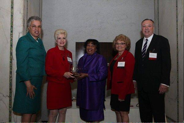 From left, Cook County President Toni Preckwinkle; Debi Stanton; Peggy Montes, chairwoman of the Commission on Women's Issues; Linda Fleming, Palatine Township supervisor and 14th District representative on the women's commission; Cook County Commissioner Gregg Goslin.